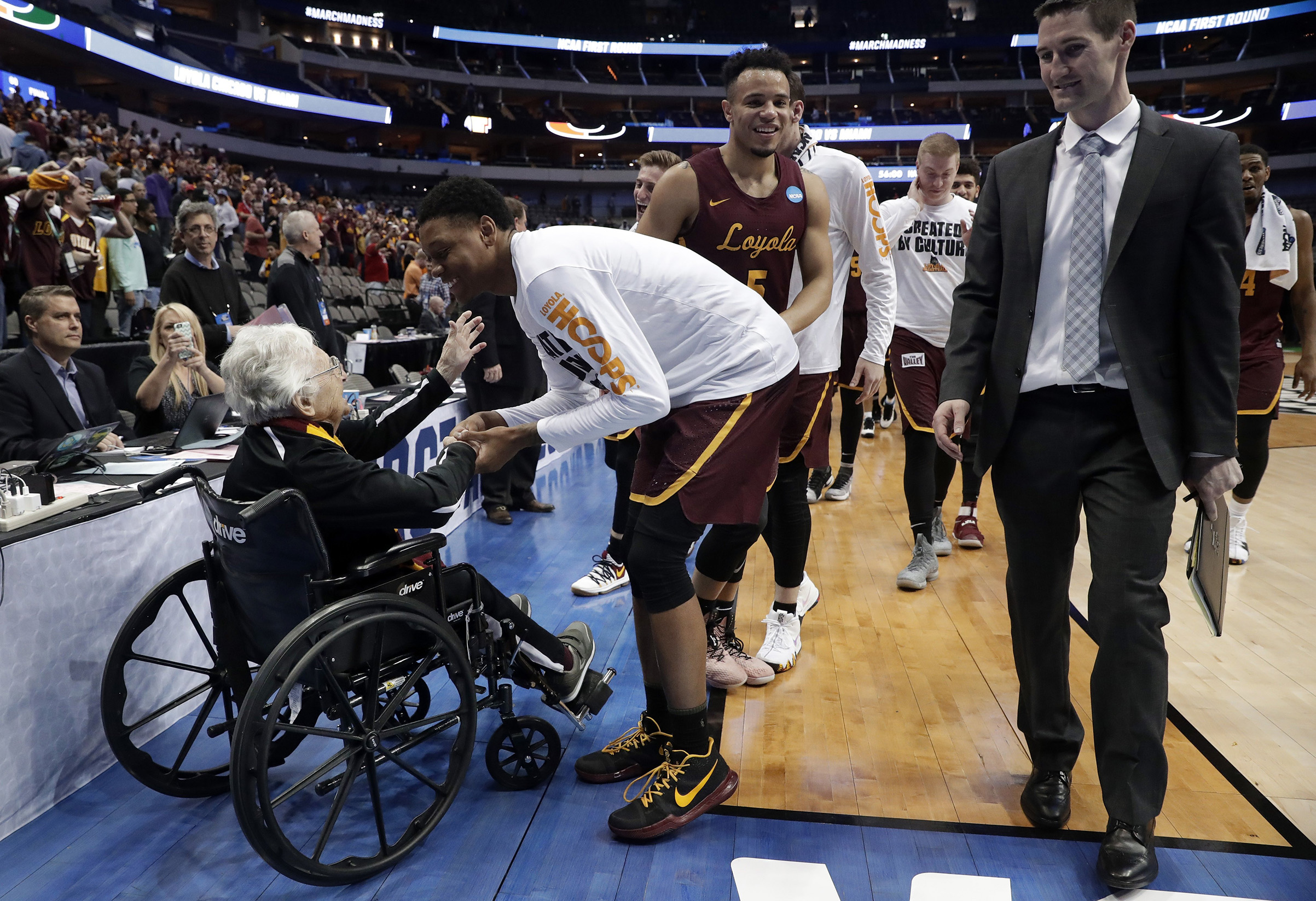 Sister Jean, the 98-year-old team chaplain for Loyola-Chicago, greets players after a win