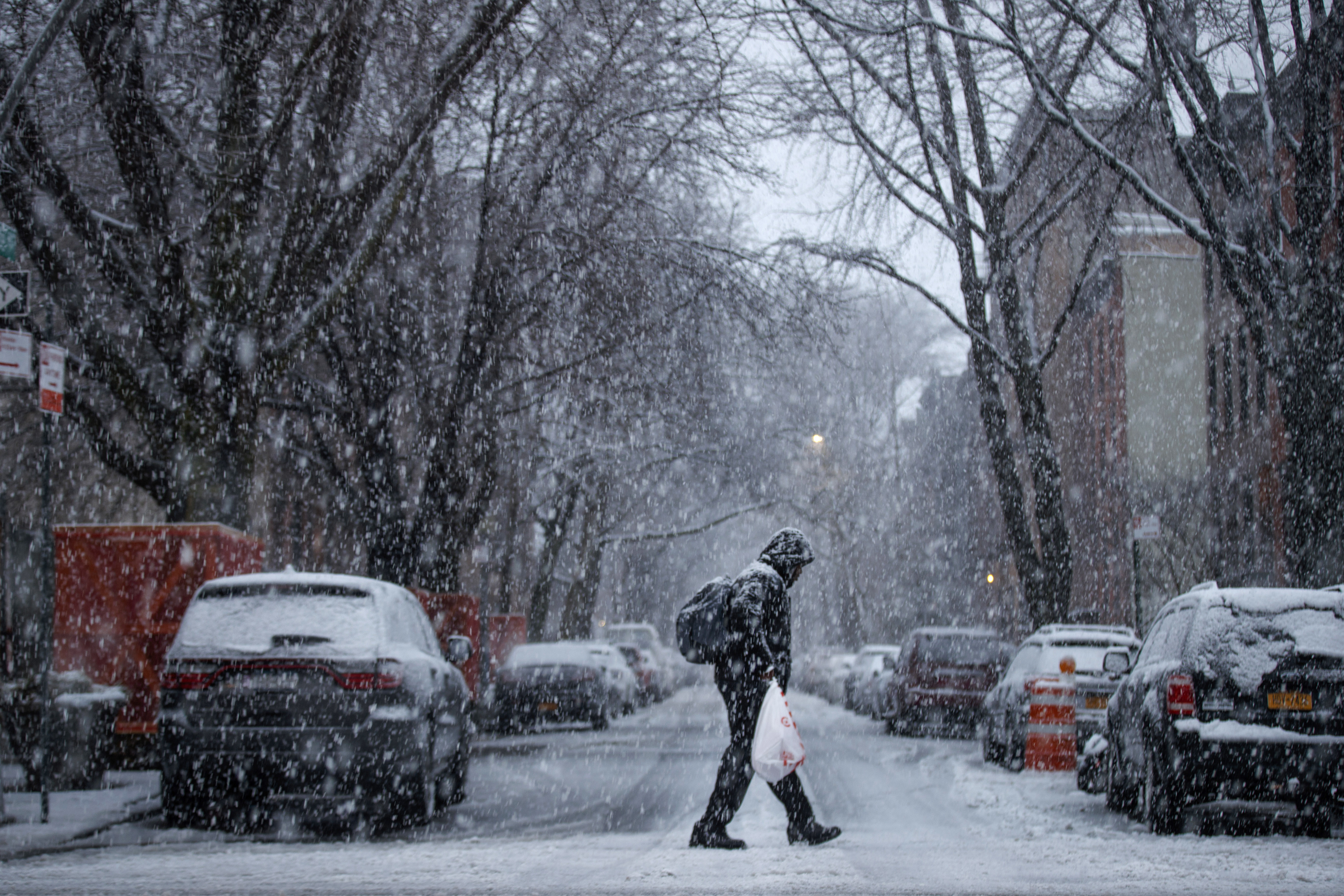 A man walks through the Boerum Hill neighborhood in Brooklyn during a snowstorm, March 7, 2018 in New York City.