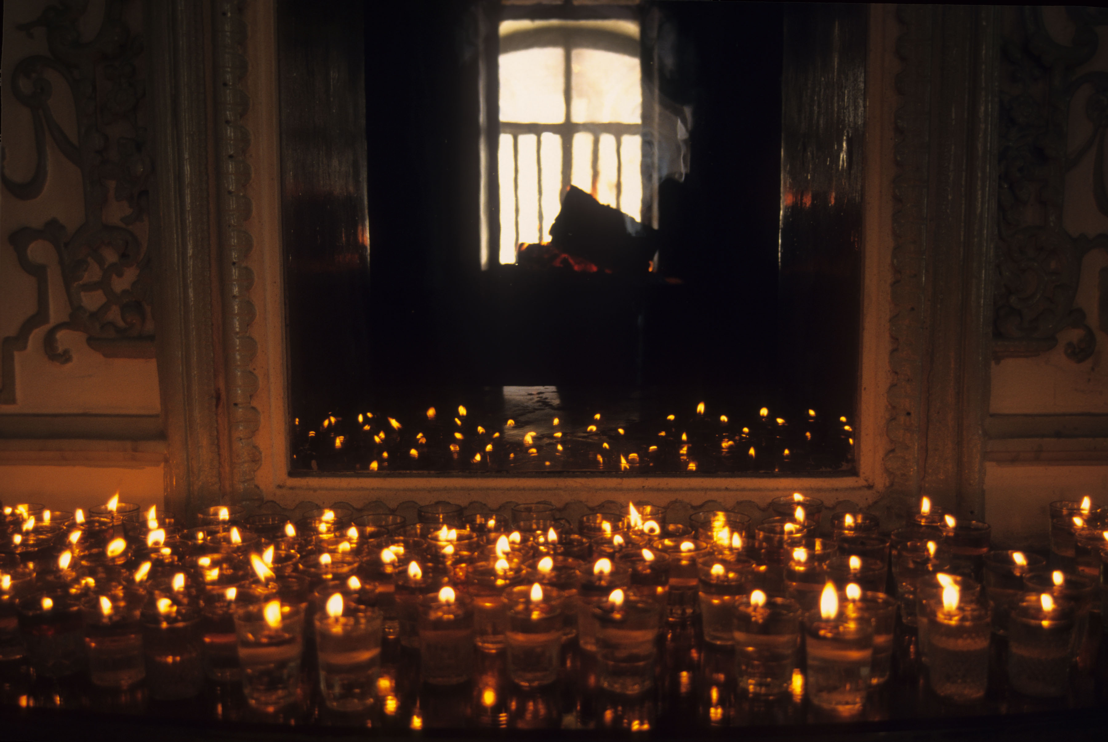 Candles in front of a mirror during a Nowruz (Iranian new year) ceremony at the Rostam Bagh Zoroastrian fire temple in Tehran, Iran, circa 1995. (Photo by Kaveh Kazemi/Getty Images)