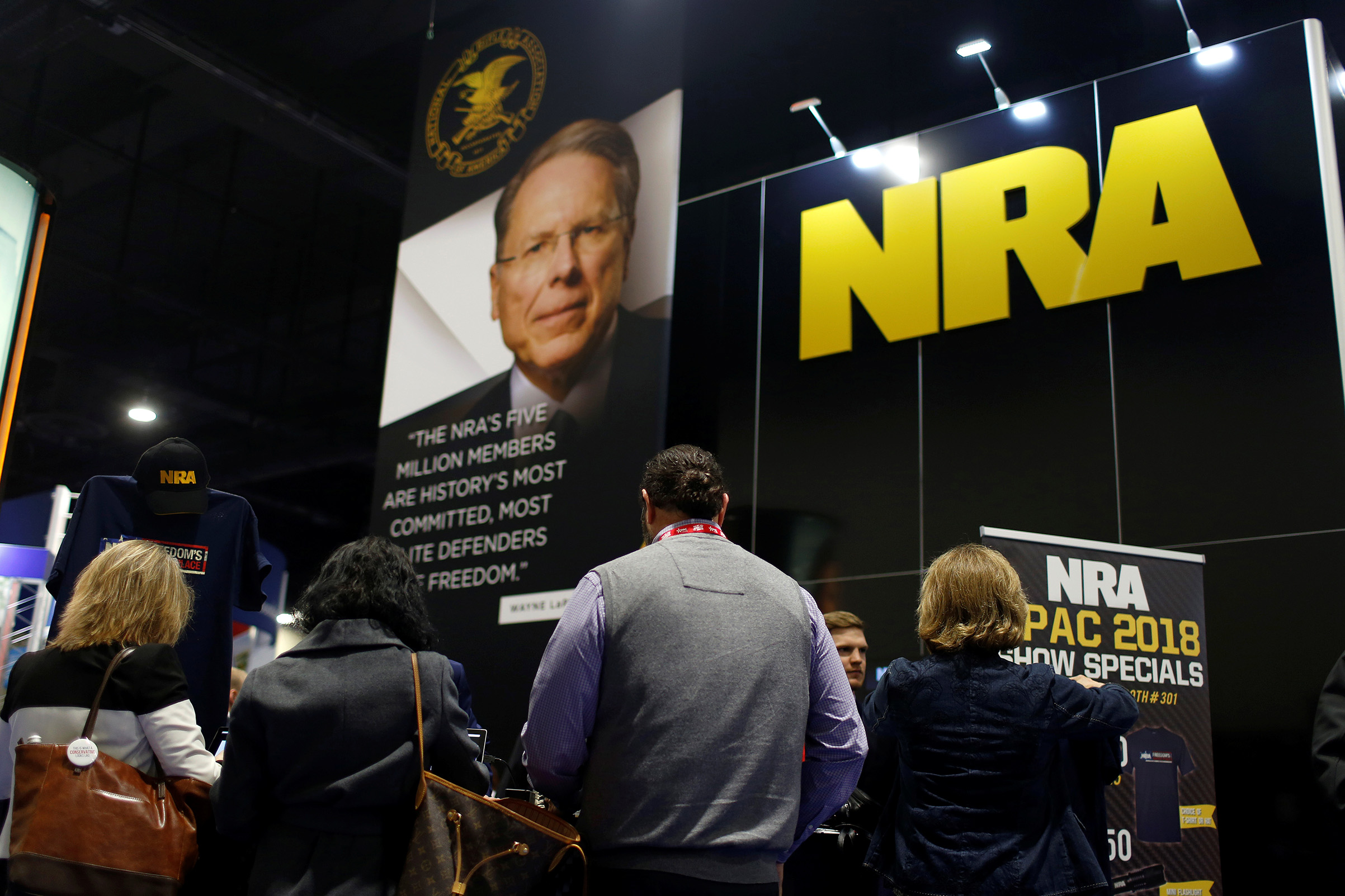 People sign up at the booth for the National Rifle Association (NRA) at the Conservative Political Action Conference (CPAC) at National Harbor, Md., on Feb. 23, 2018.