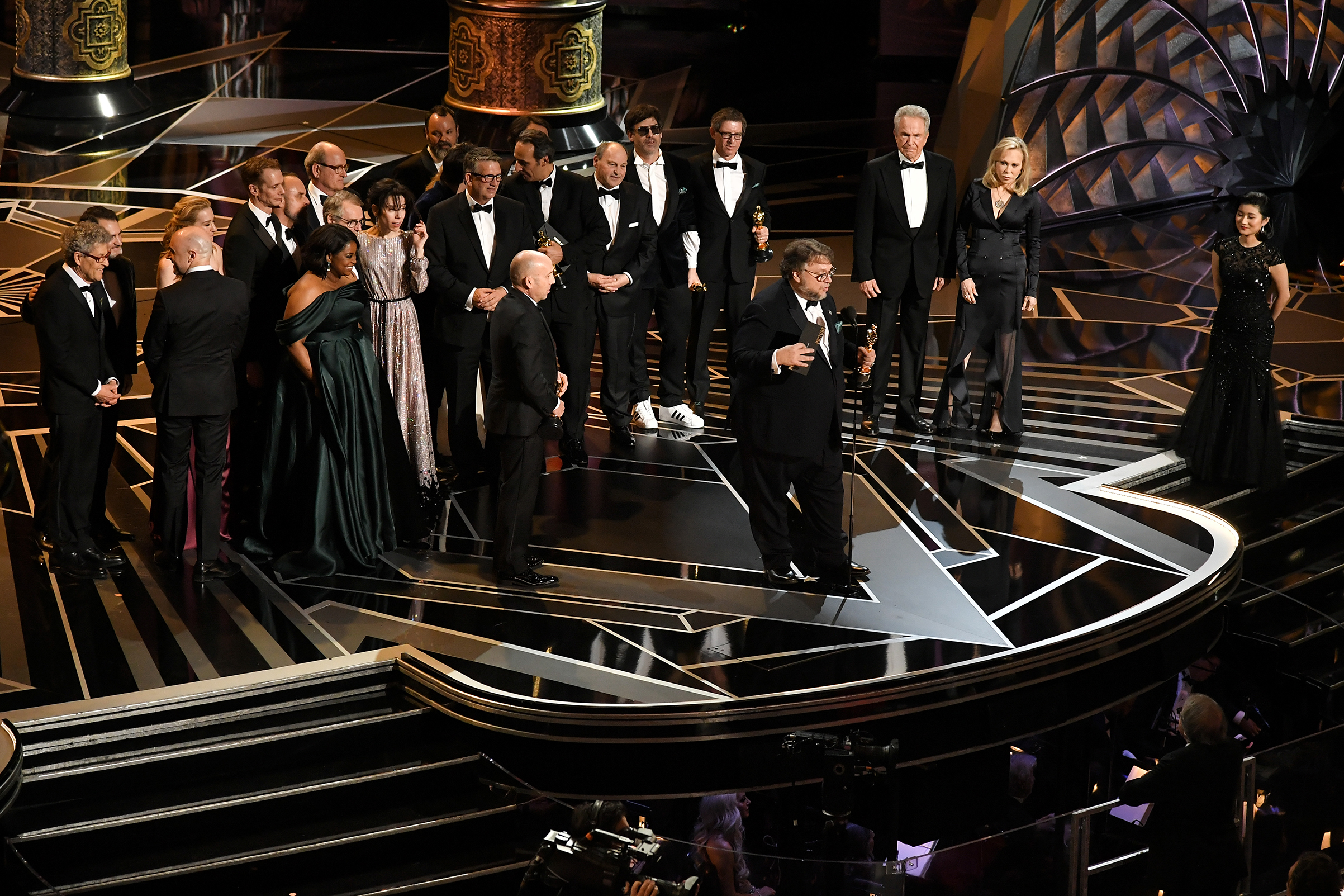 Guillermo del Toro with cast and crew 'The Shape Of Water' as they accept the award for Best Picture at the 90th Annual Academy Awards on March 4, 2018.