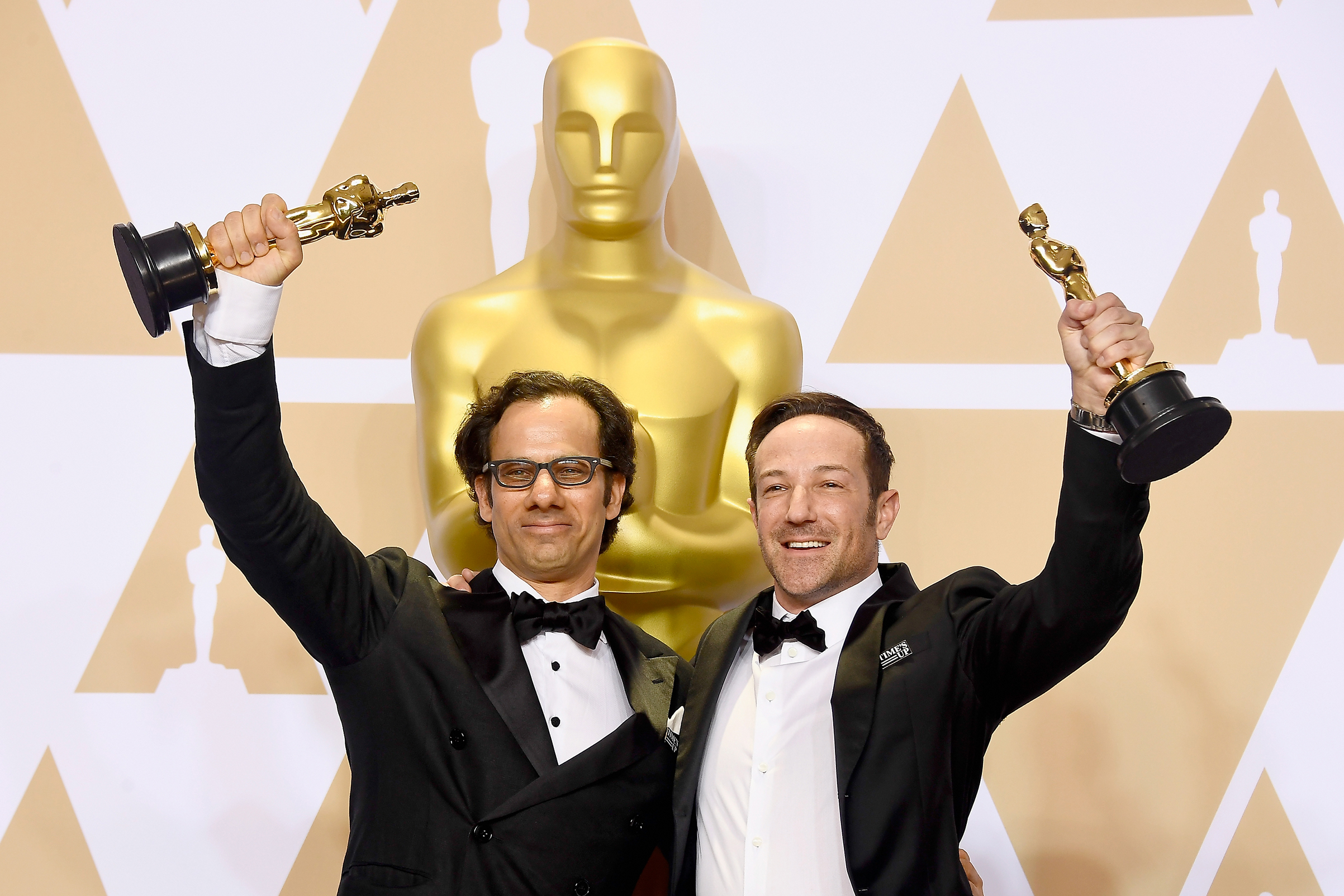 Producer Dan Cogan and director Bryan Fogel, winners of the Best Documentary Feature award for 'Icarus,' pose in the press room during the 90th Annual Academy Awards at Hollywood & Highland Center on March 4, 2018 in Hollywood.