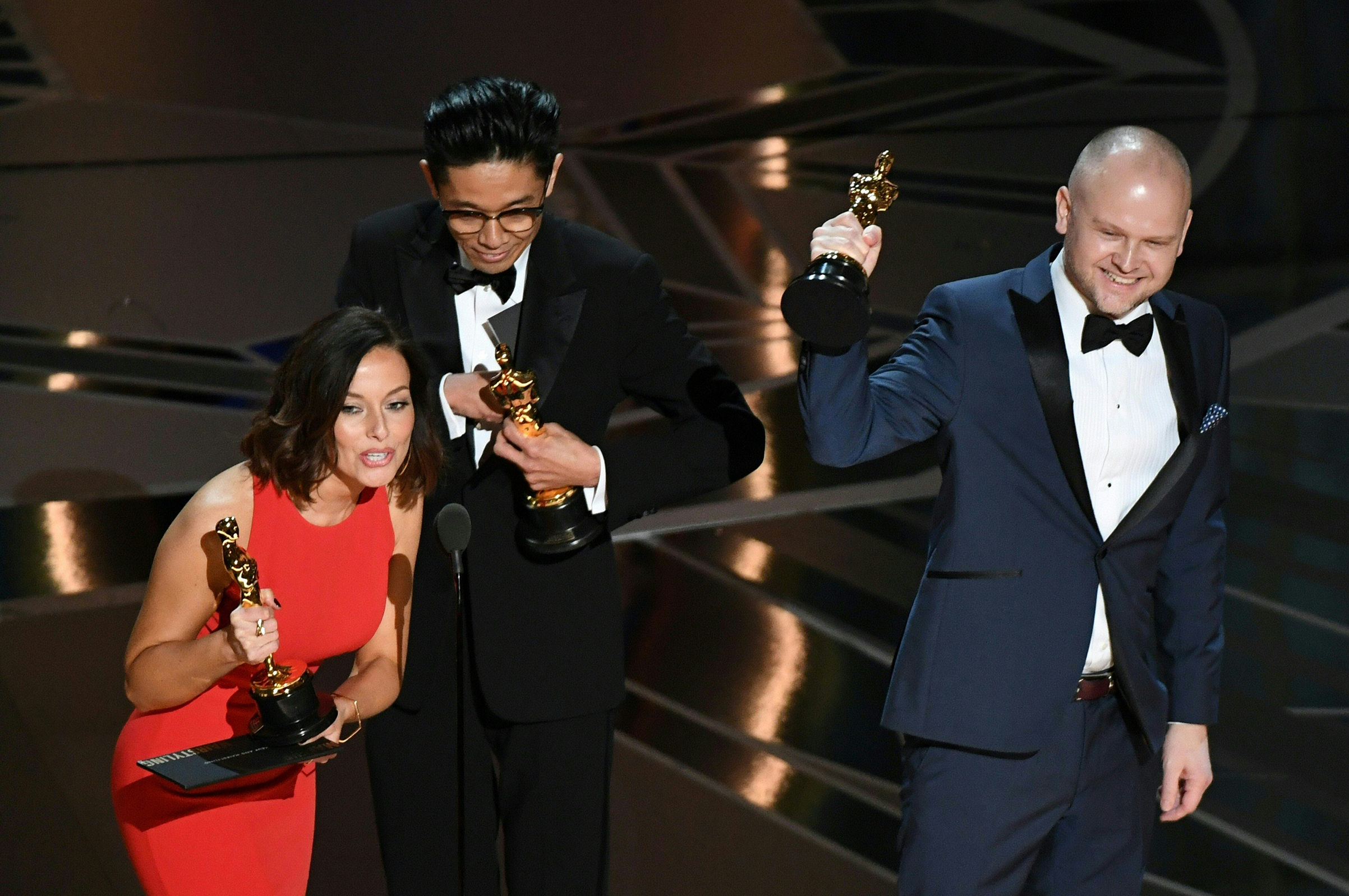 Make-Up and Hairstyling artists Lucy Sibbick, Kazuhiro Tsuji and David Malinowski accept the Oscar for Best Makeup and Hairstyling in Darkest Hour during the 90th Annual Academy Awards show on March 4, 2018 in Hollywood.