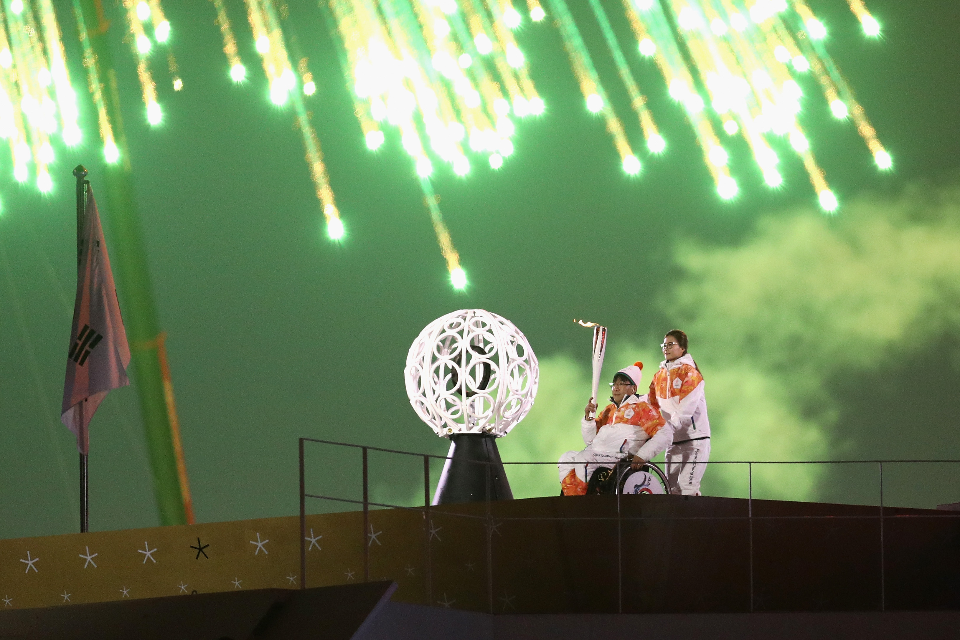 Seo Soonseok and Kim EunJung carries the torch during the opening ceremony of the PyeongChang 2018 Paralympic Games at the PyeongChang Olympic Stadium on March 9, 2018 in Pyeongchang-gun, South Korea.