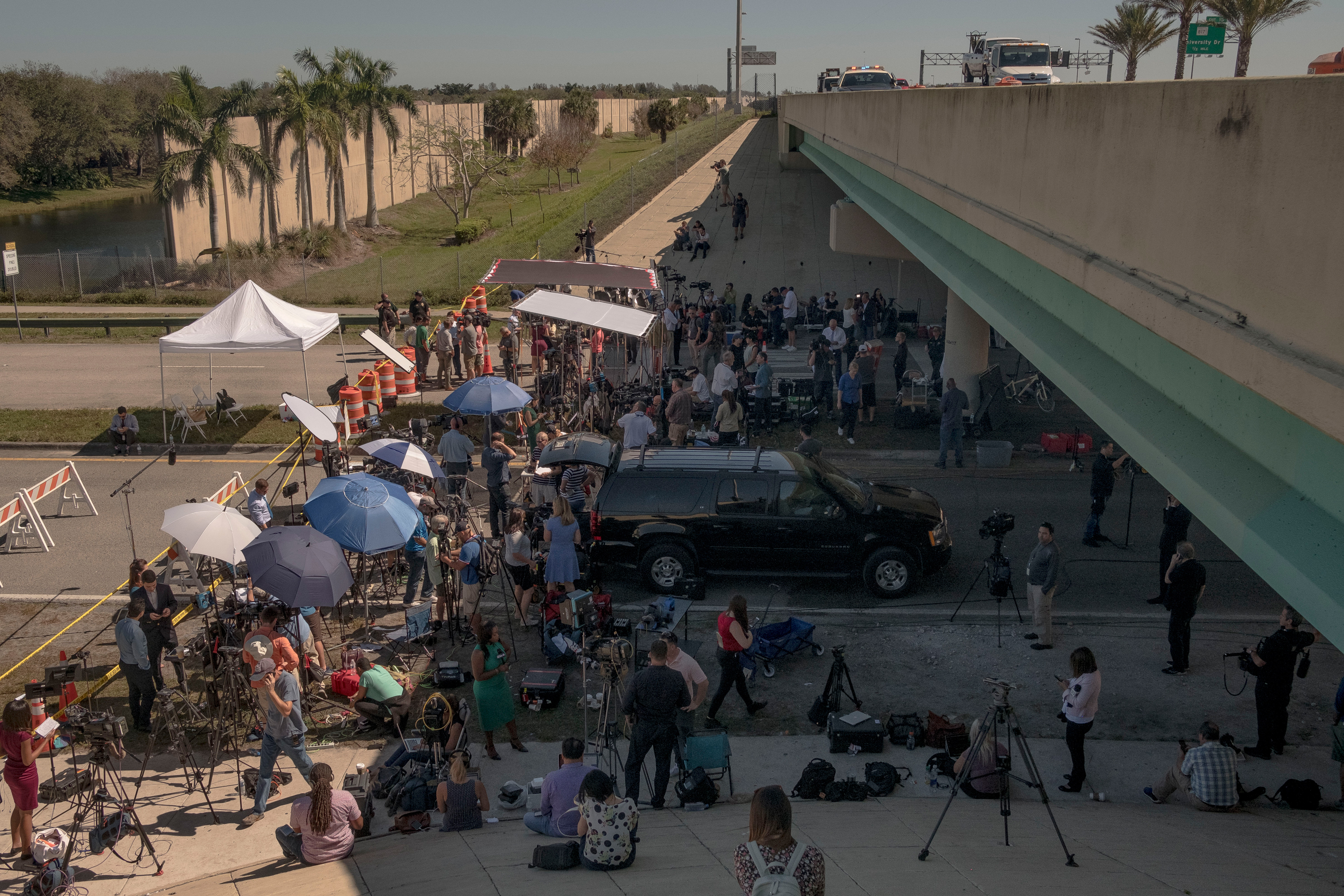 In the days after the shooting, television media congregated under the overpass outside of Marjory Stoneman Douglas, creating a staging area for stand ups and press conferences. It was the closest anyone could get to the school and to any news of what was happening.