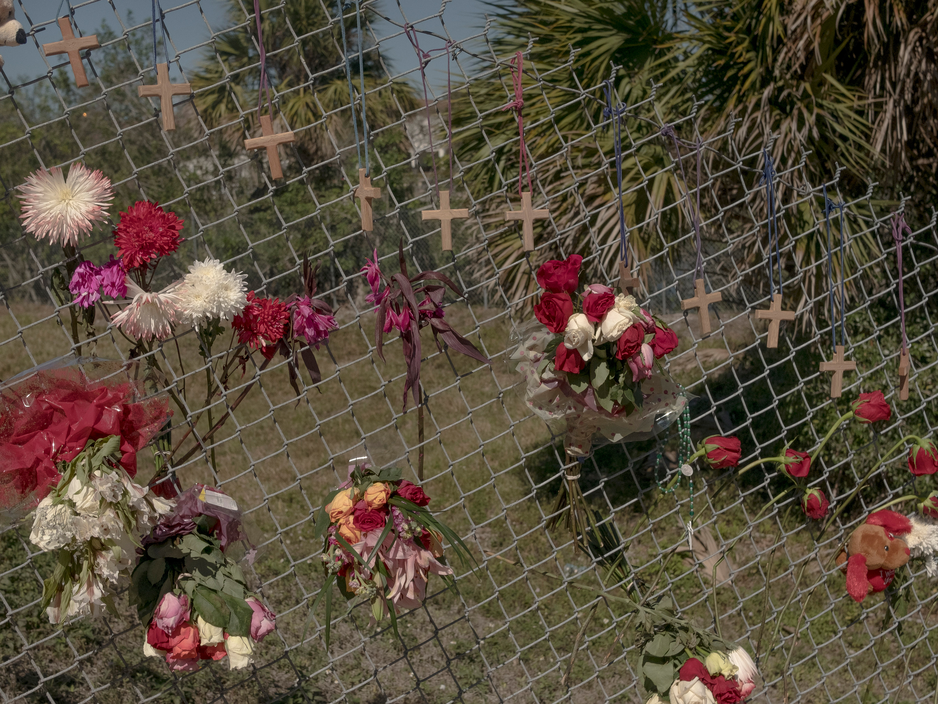 Flowers and crosses were put up on a fence across from the high school, the closest anyone could get to the school after the shooting.