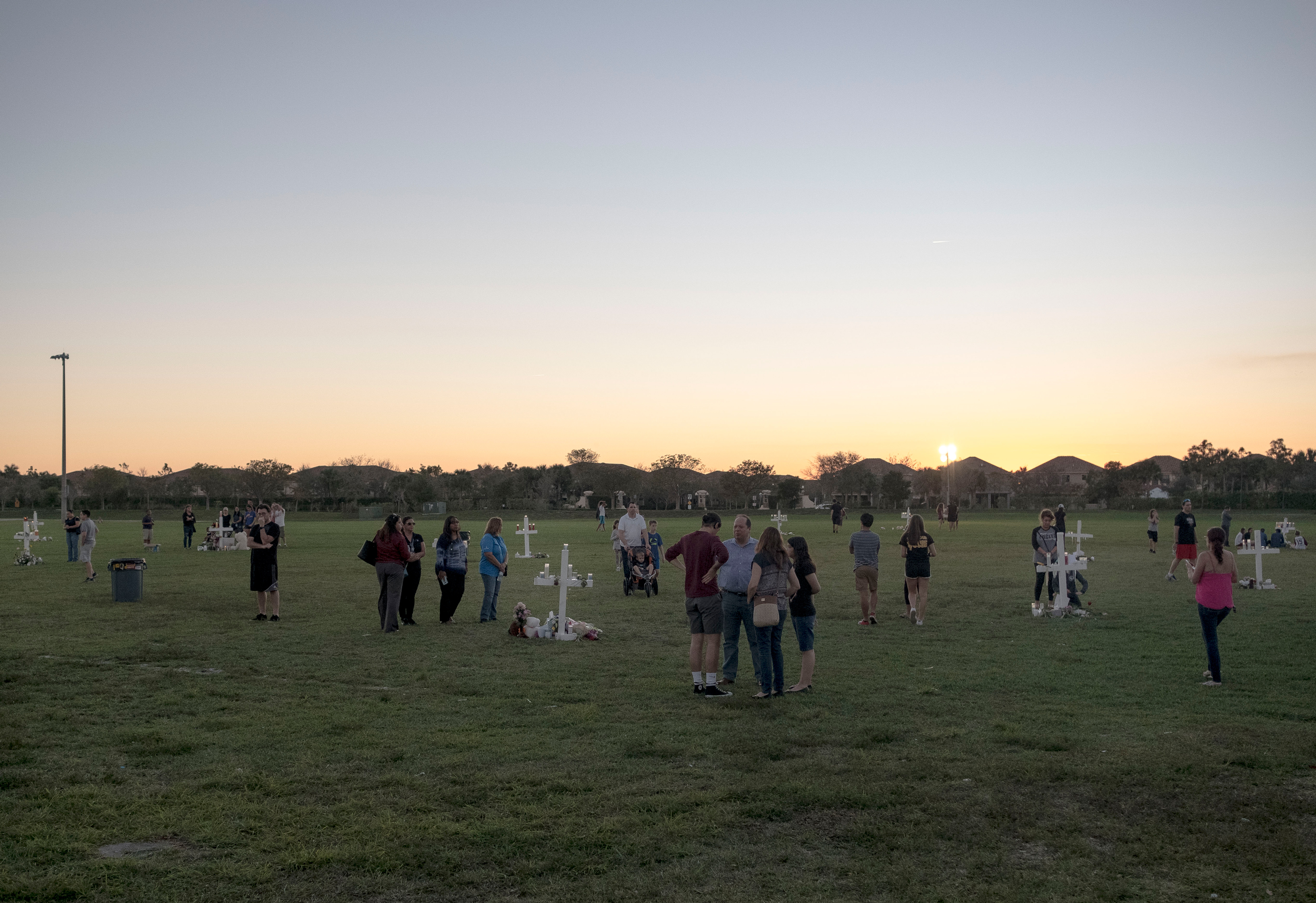 17 crosses were placed at Pine Trails Park in Parkland before the candlelight vigil memorializing the victims who lost on Valentine's day. What was a public field for families to gather in support of loved ones during soccer games, became a memorial site to mourn the lives lost in the shooting.