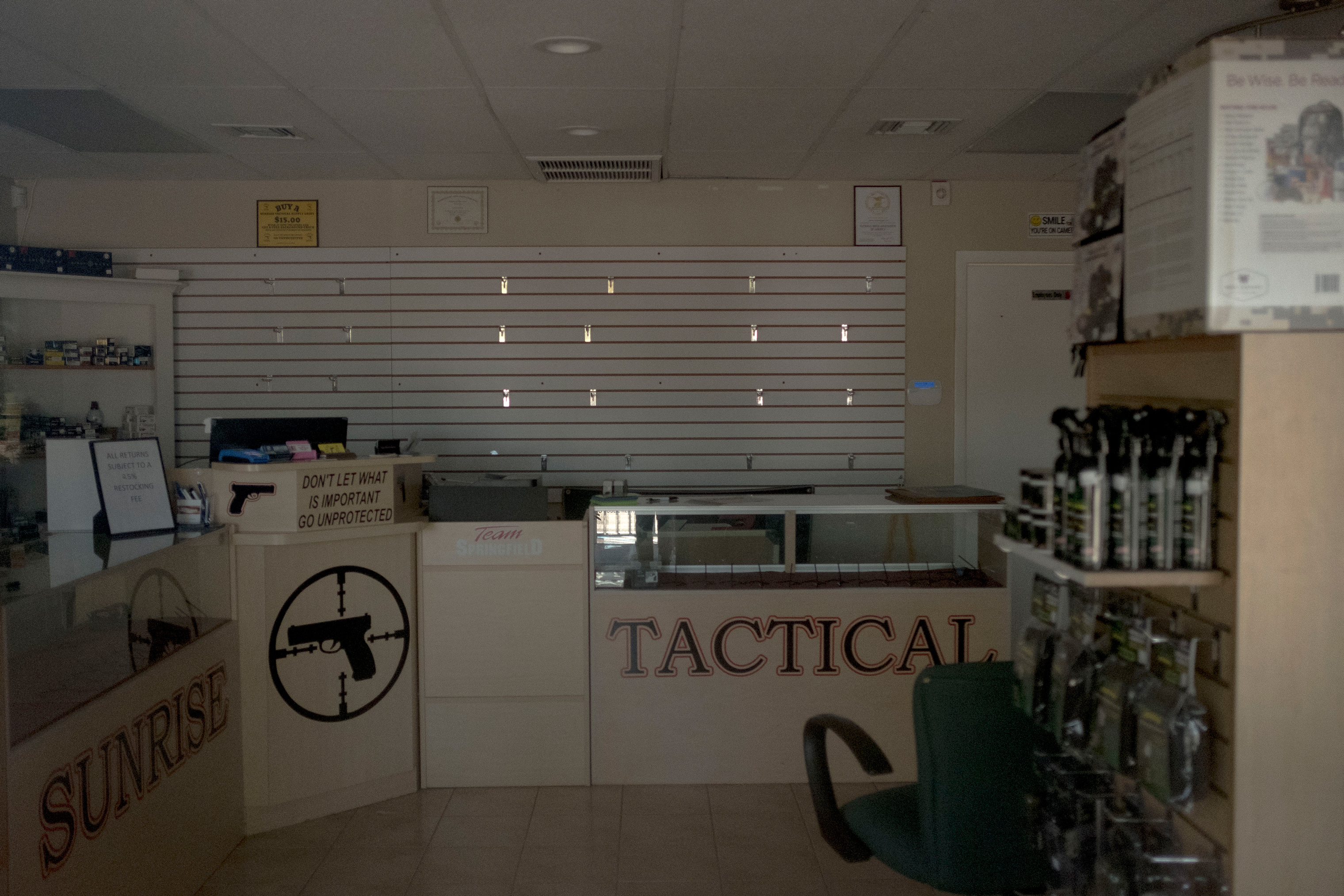 "Sunrise Tactical Supply in Coral Springs, where accused shooter Nikolas Cruz bought his weapon. Just down the street from the high school, the store lay mostly empty and was closed indefinitely. A sign at the window stated ""God Bless Our Troops…Especially Our Snipers."""