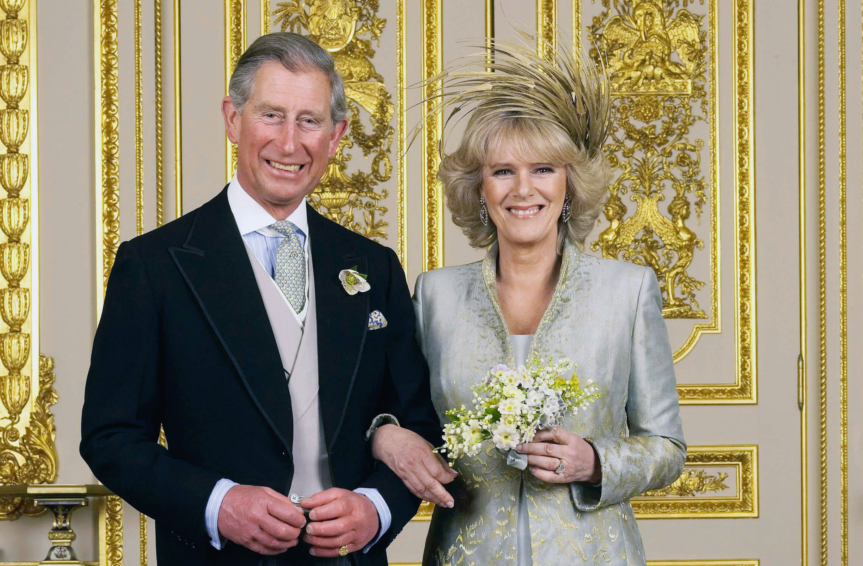 Prince Charles, the Prince of Wales, and his wife Camilla, the Duchess Of Cornwall, pose in the White Drawing Room at Windsor Castle for the Official Wedding photograph following their marriage on April 9, 2005 in Windsor, England. Tim Graham/Getty Images