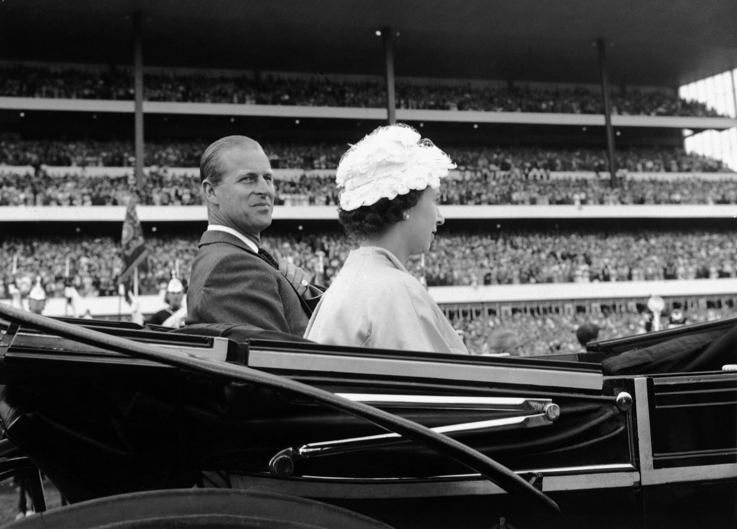 Her Majesty Queen Elizabeth II and her husband Prince Philip, Duke of Edinburgh, arrive in a carriage to attend the opening ceremonies of the 100th running of the Queen's Plate in Toronto on June 30, 1959.