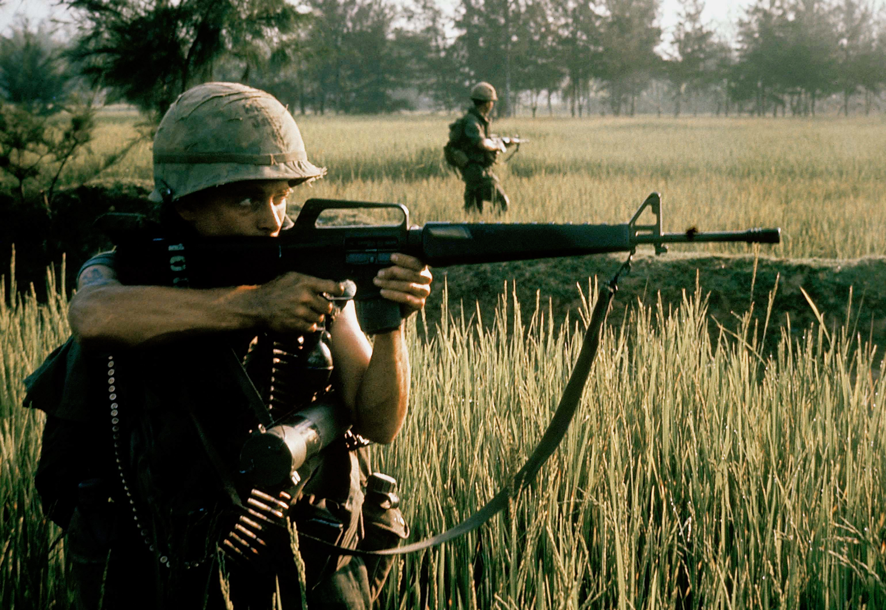 An American soldier fires his M16 rifle near My Lai on March 16, 1968.