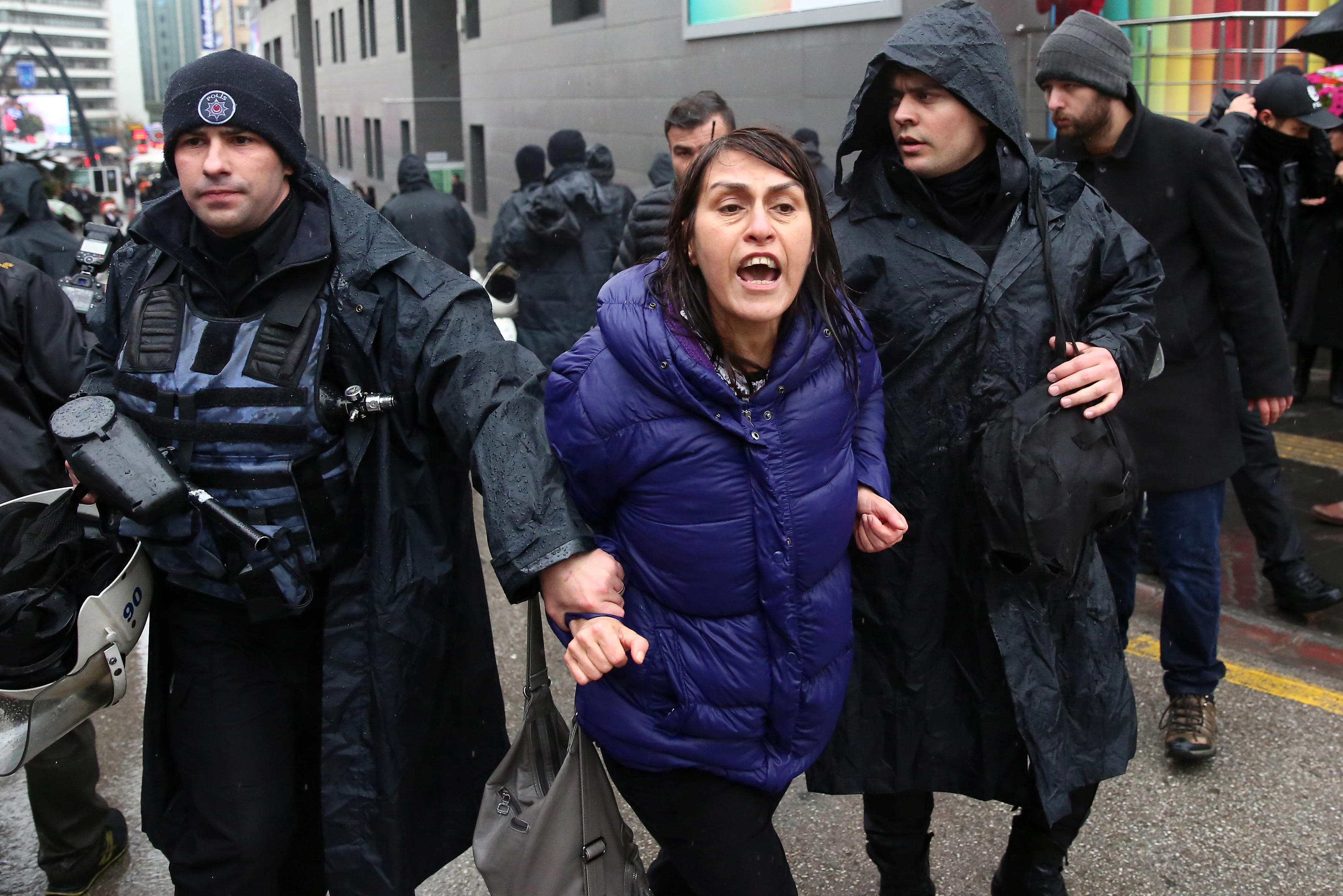 A woman is detained by riot police during a Women's Day rally in Ankara, Turkey on March 4, 2018.