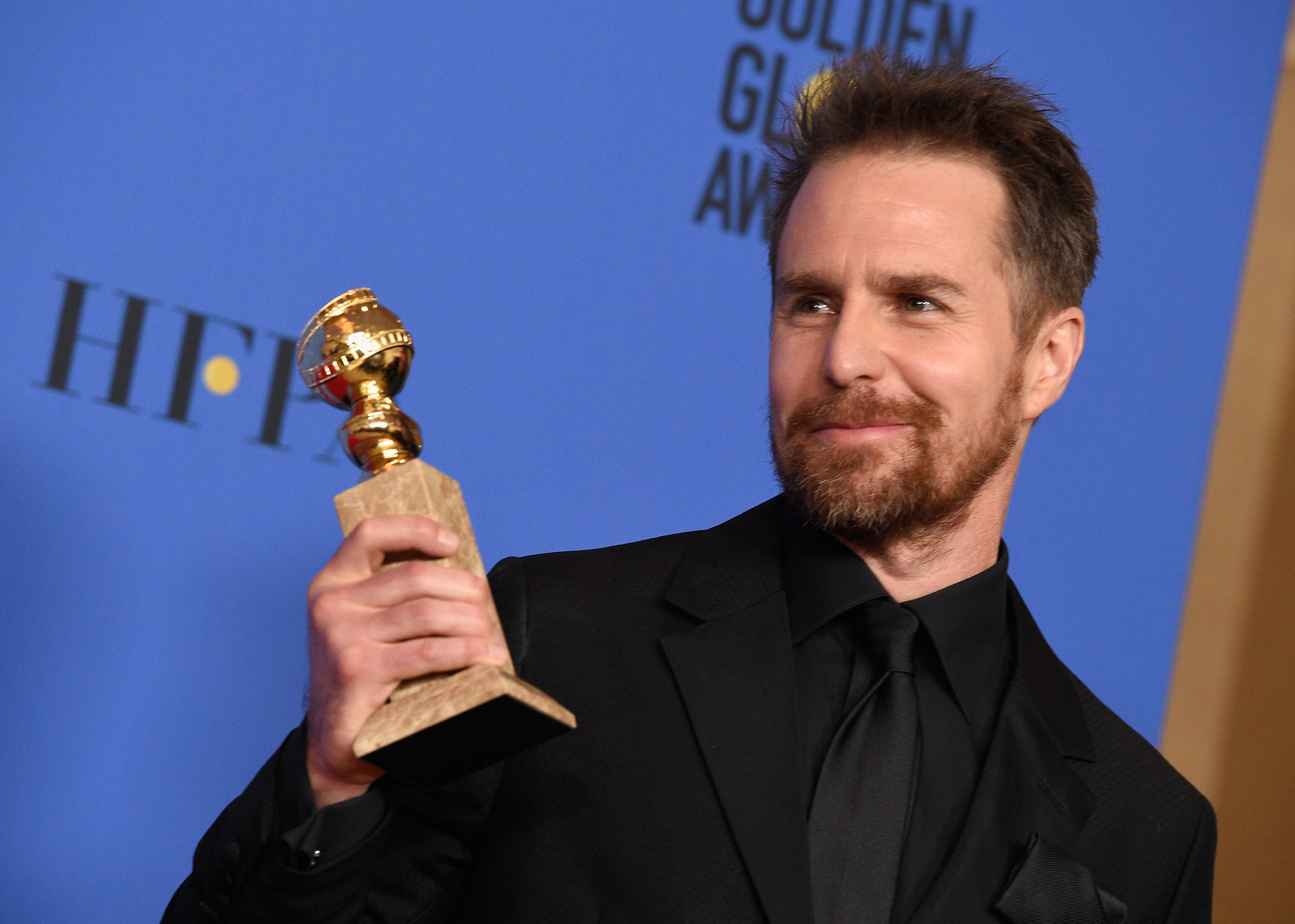 Sam Rockwell poses with best supporting actor award for 'Three Billboards Outside Ebbing, Missouri' at the 75th Annual Golden Globe Awards on January 7, 2018.