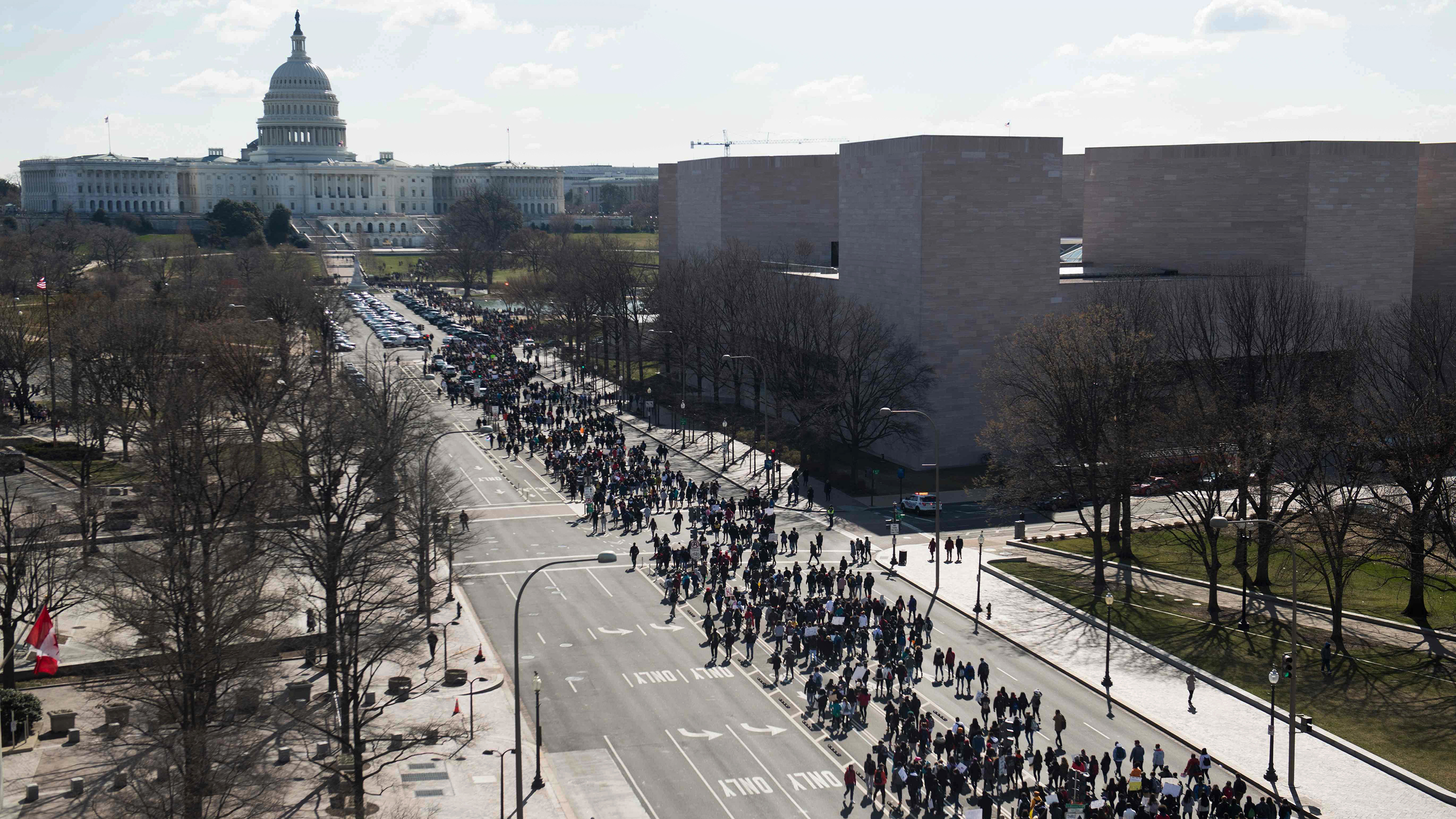 Thousands of local students march down Pennsylvania Avenue to the US Capitol during a nationwide student walkout for gun control in Washington, DC, March 14, 2018.                     Students across the US walked out of classes on March 14, in a nationwide call for action against gun violence following the shooting deaths last month at a Florida high school. The nationwide protest is being held one month to the day after Nikolas Cruz, a troubled 19-year-old former student at Stoneman Douglas, unleashed a hail of gunfire on his former classmates. / AFP PHOTO / SAUL LOEBSAUL LOEB/AFP/Getty Images