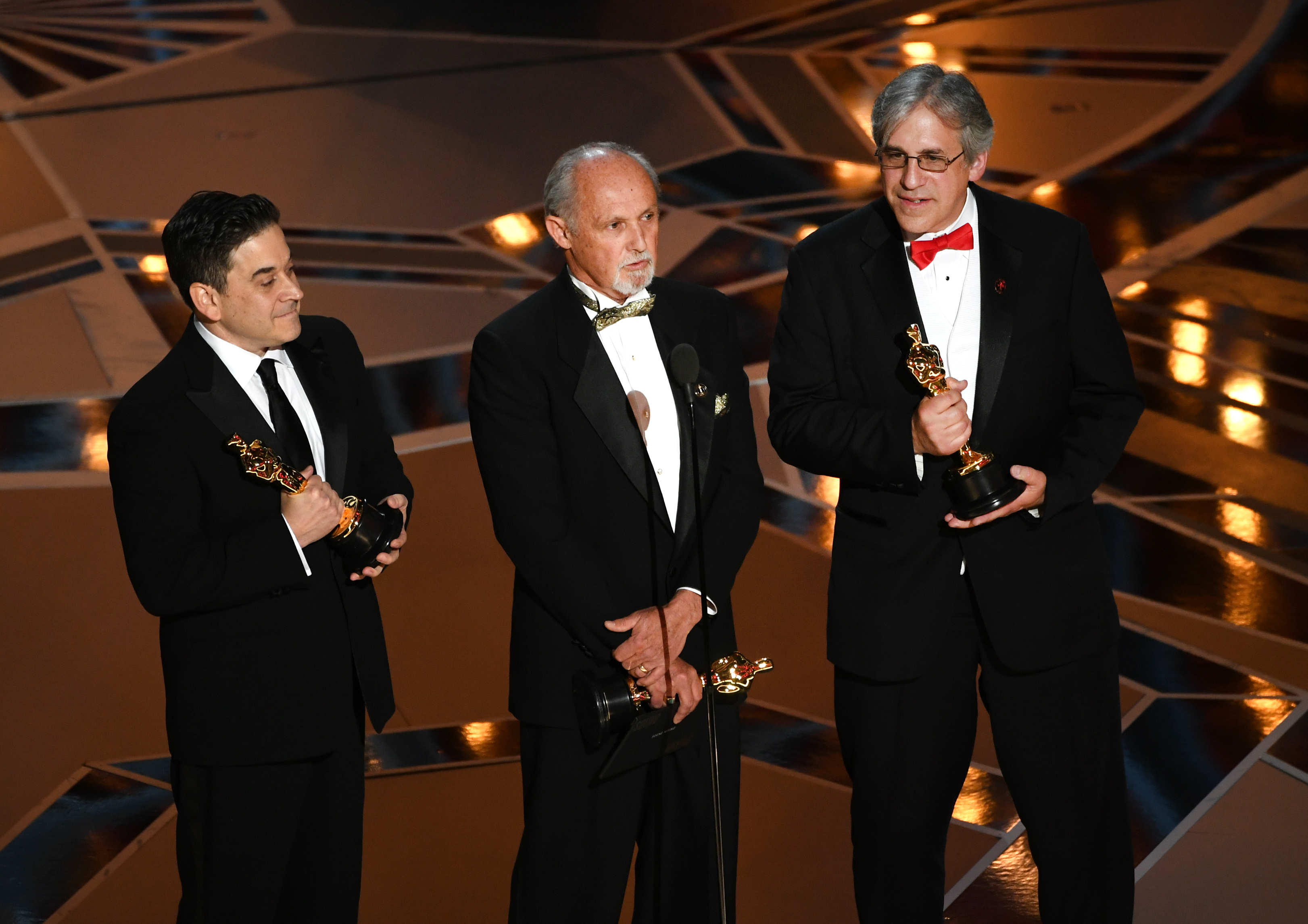 Sound mixers Gary A. Rizzo, Gregg Landaker and Mark Weingarten accept Best Sound Mixing for 'Dunkirk' onstage during the 90th Annual Academy Awards at the Dolby Theatre at Hollywood & Highland Center on March 4, 2018 in Hollywood.