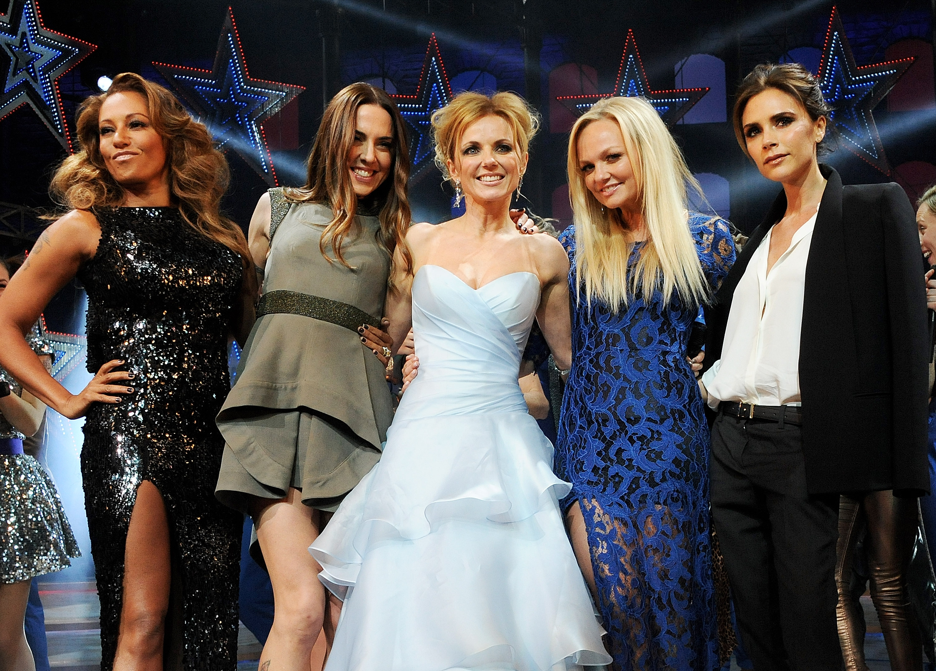 Melanie Brown, Melanie Chisholm, Geri Halliwell, Emma Bunton and Victoria Beckham bow at the curtain call during the Gala Press Night performance of 'Viva Forever' at the Piccadilly Theatre on December 11, 2012 in London, England.