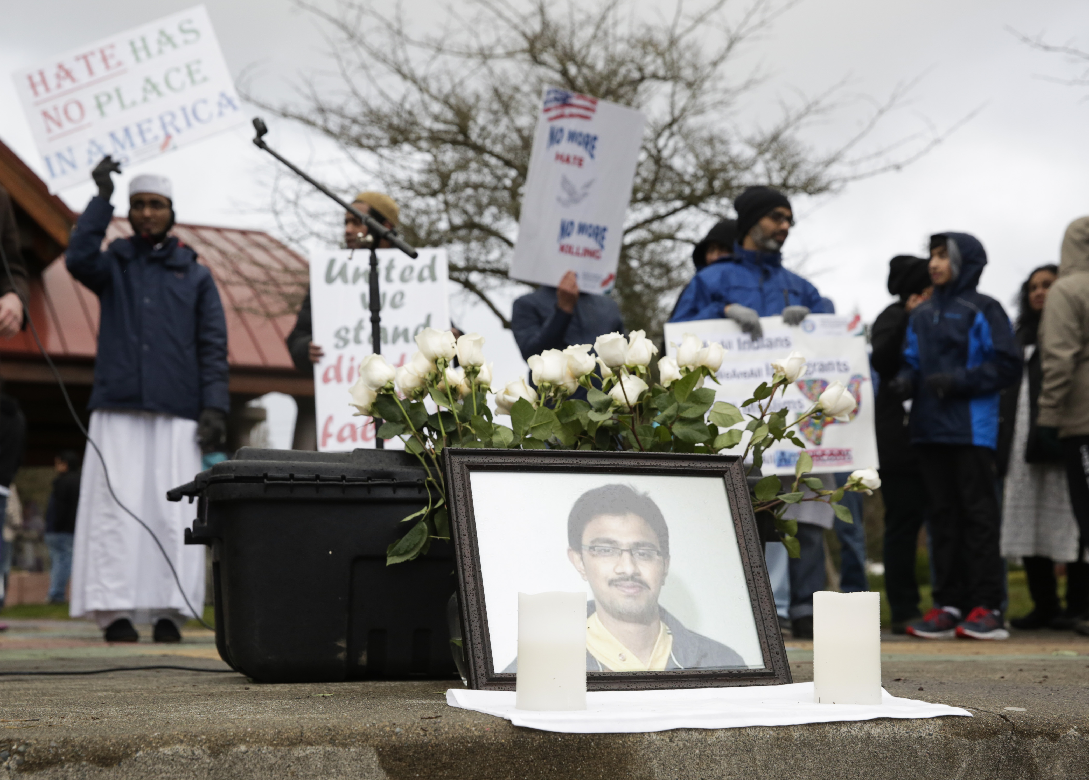 A photo of Srinivas Kuchibhotla, the 32-year-old Indian engineer killed at a bar in Olathe, Kansas, is pictured during a peace vigil in Bellevue, Washington on March 5, 2017
