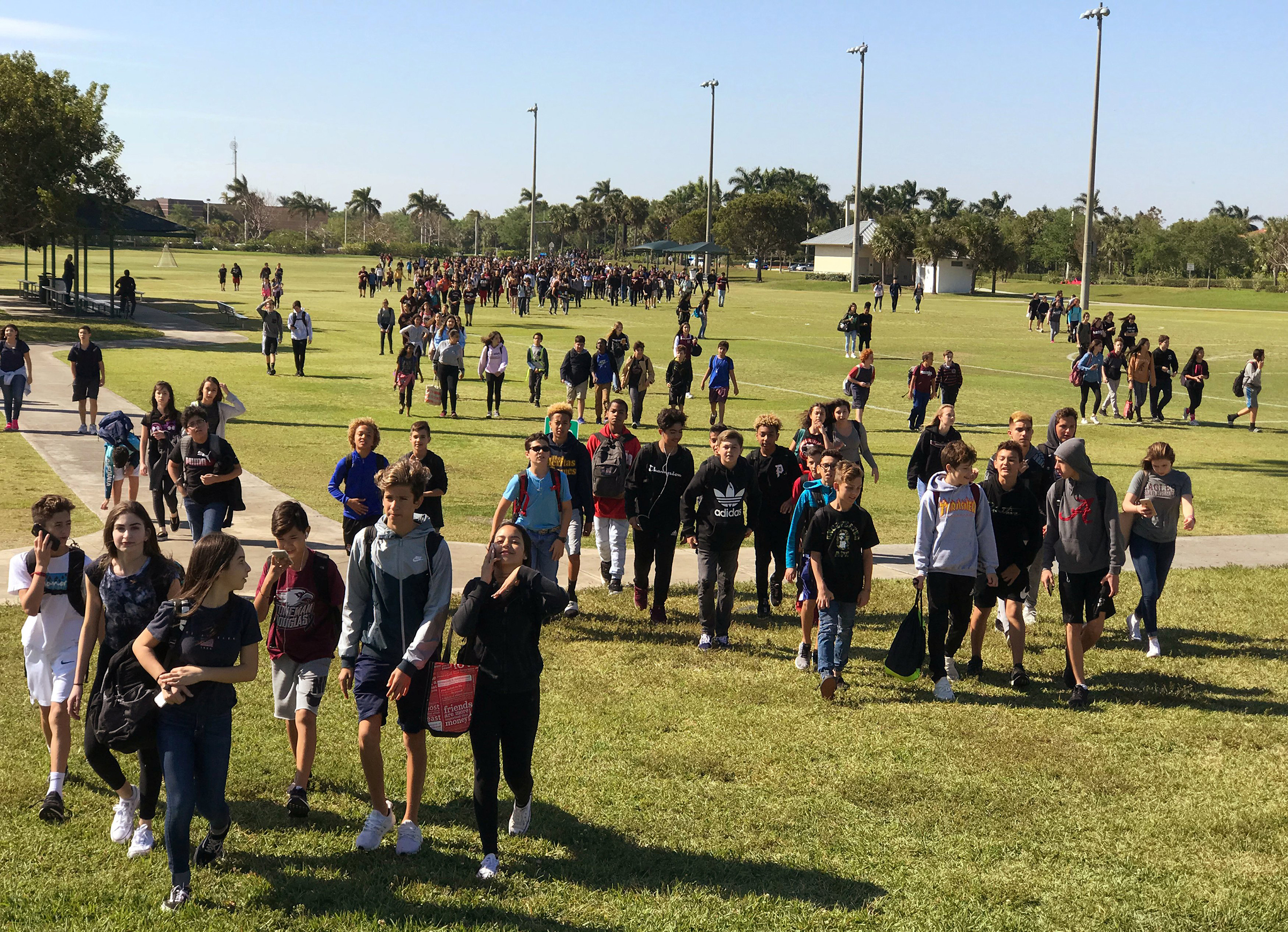 Students from West Lakes Middle School and Marjory Stoneman Douglas High School walkout during National School Walkout to protest gun violence in Parkland, Fla., March 14, 2018.