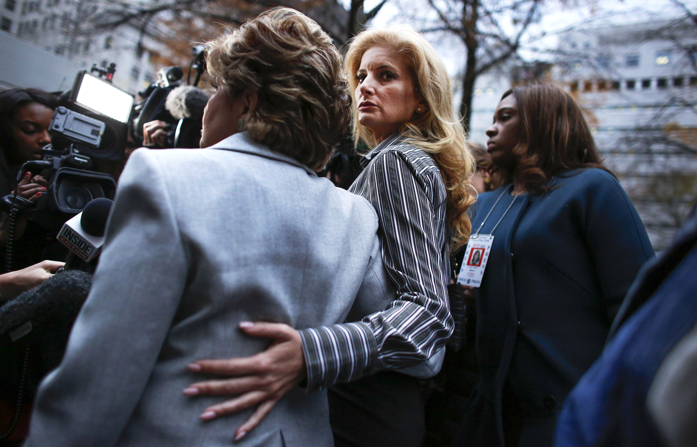 Summer Zervos a former contestant on  The Apprentice  looks at the camera as she embraces lawyer Gloria Allred after they leave the New York County Criminal Court on Dec. 5, 2017.