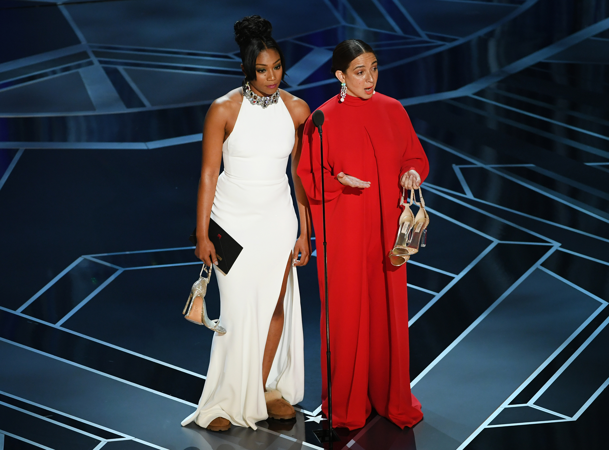Actors Tiffany Haddish and Maya Rudolph speak onstage during the 90th Annual Academy Awards at the Dolby Theatre at Hollywood & Highland Center on March 4, 2018 in Hollywood.