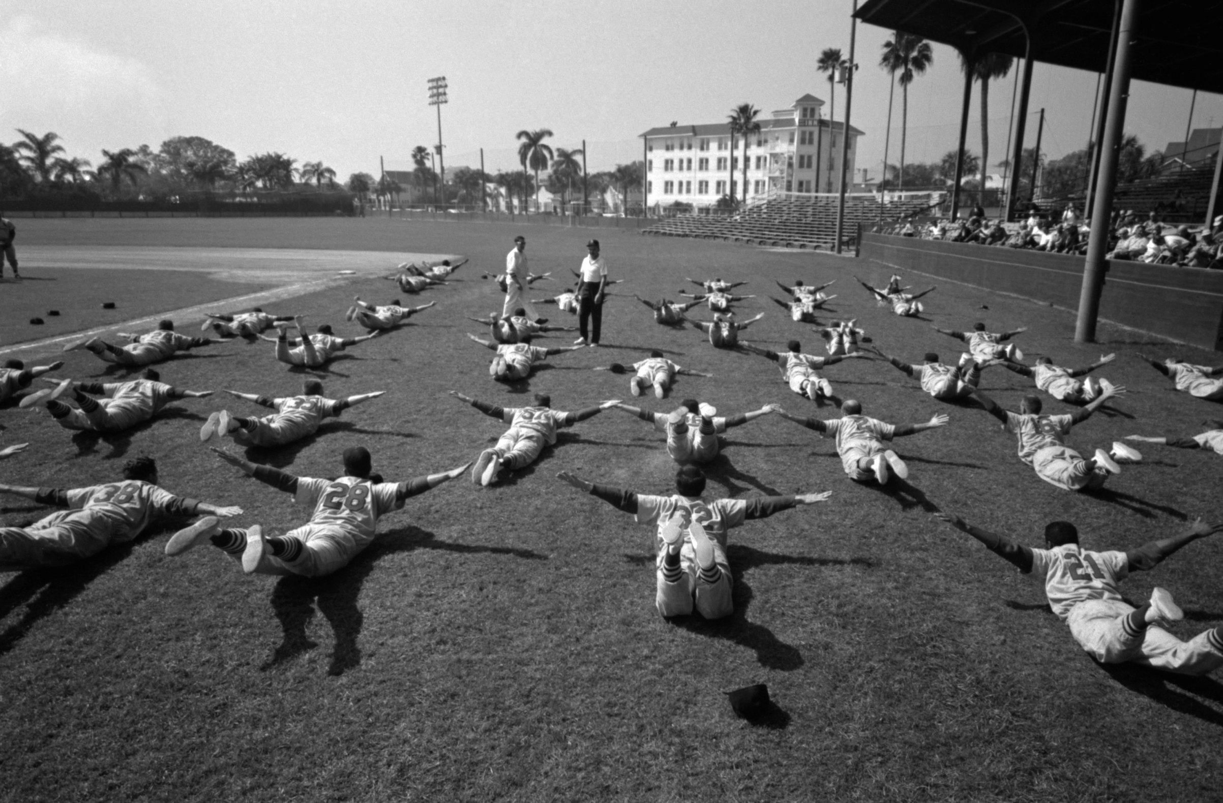Members of the St. Louis Cardinals stretch during Spring Training in March, 1960 at Al Lang Field in St. Petersburg, Fla.
