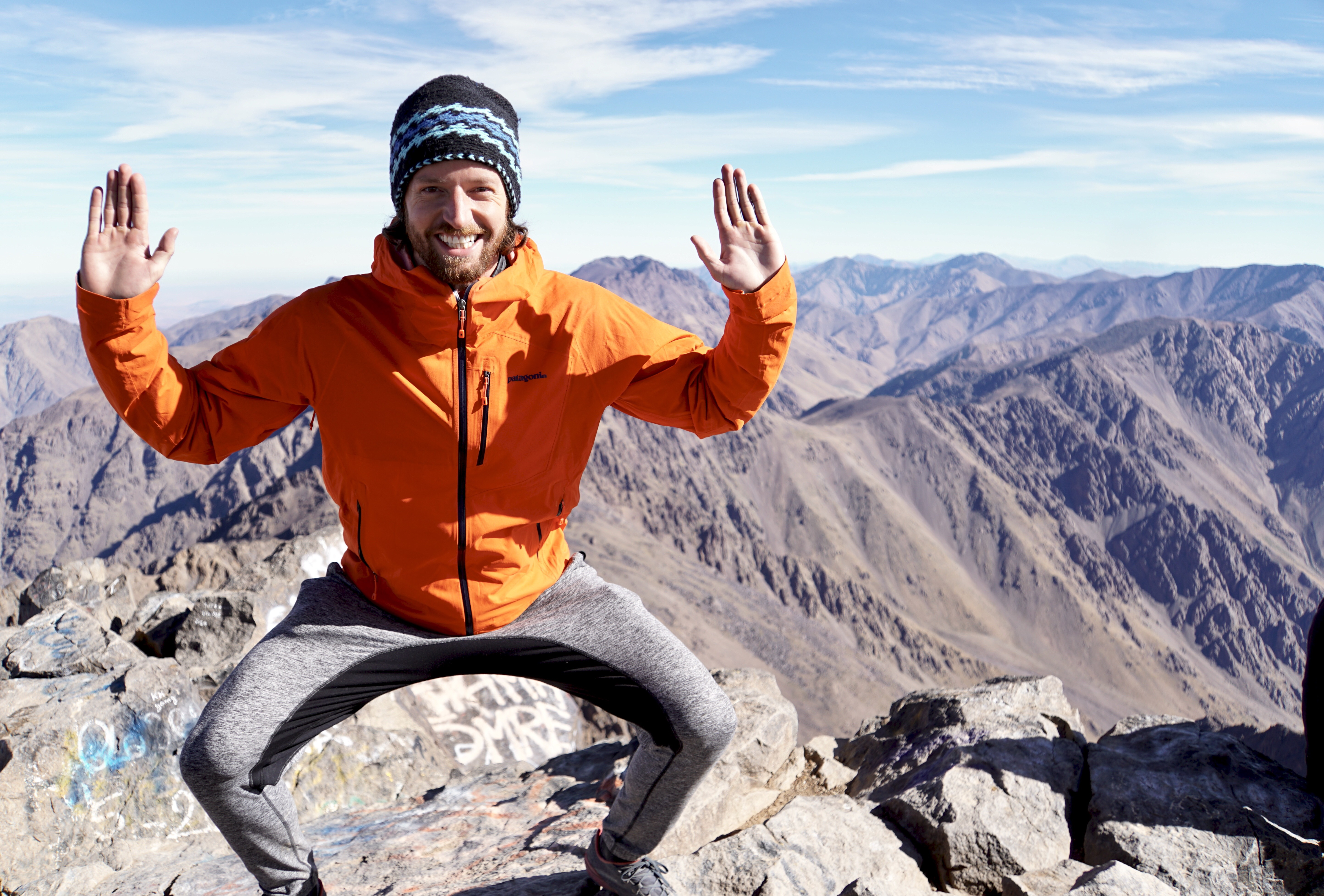 Trevor Gerhardt practicing a yoga pose on top of Toubkal, the tallest mountain in North Africa, located in Morocco