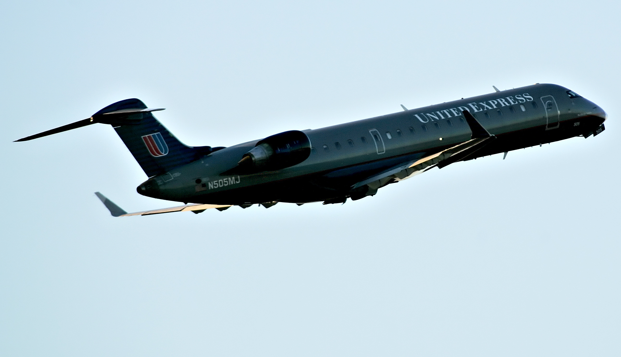 A UAL Corp. United Express/Mesa Airlines Bombardier CL600-2C10 jet (N505MJ) takes off at Raleigh-Durham International Airport in Raleigh, North Carolina, U.S., on Friday, Nov. 6, 2009. Airline passenger traffic through September this year dropped 5.3 percent, and the International Air Transport Association (IATA) which represents 93 percent of all international traffic flown, predicts a combined loss of about $11 billion for the world's airlines.