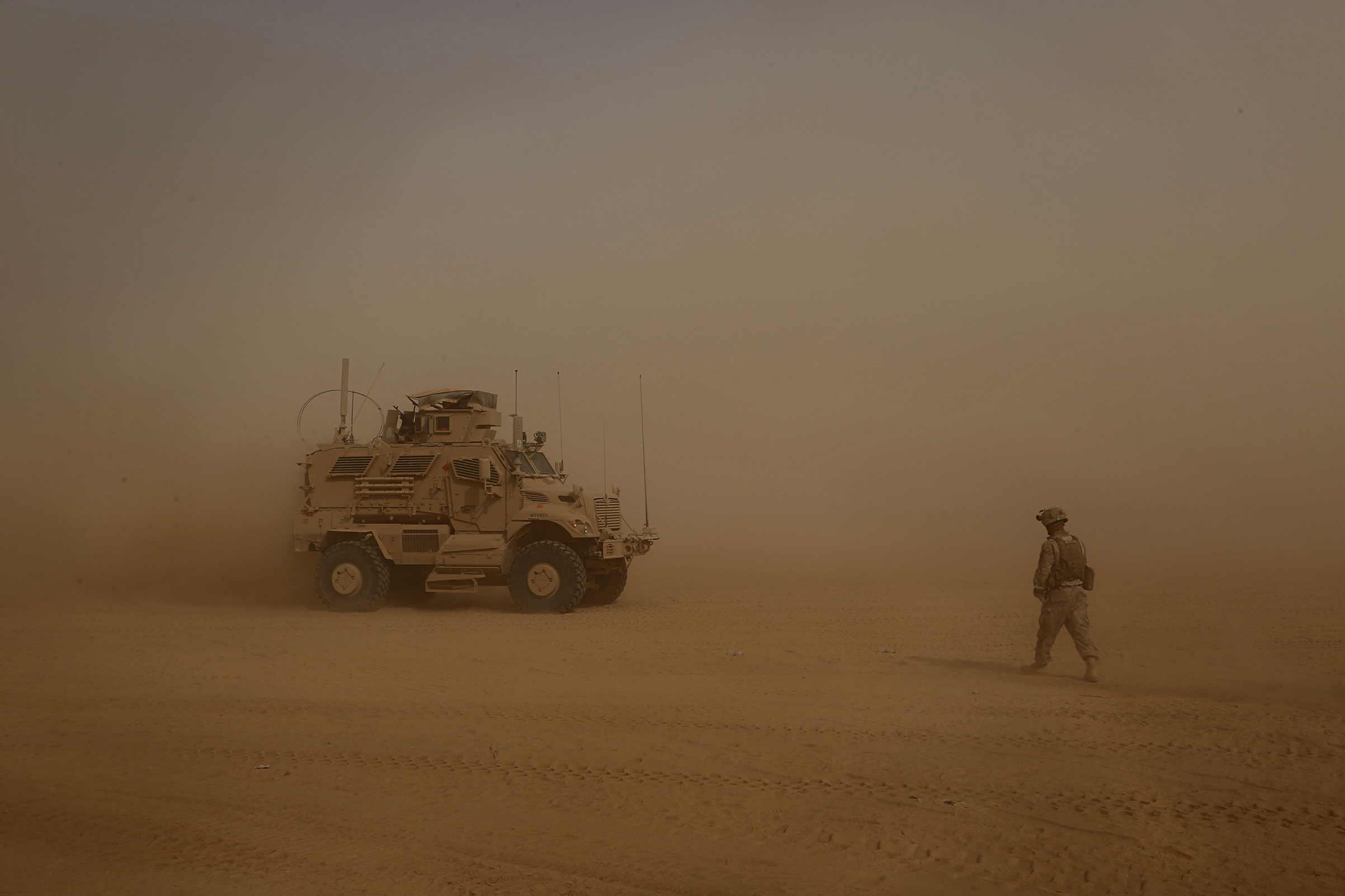 U.S. Marines prepare to build a military outpost in the fight against ISIS during a sandstorm in western Anbar, Iraq, on Nov. 6, 2017.
