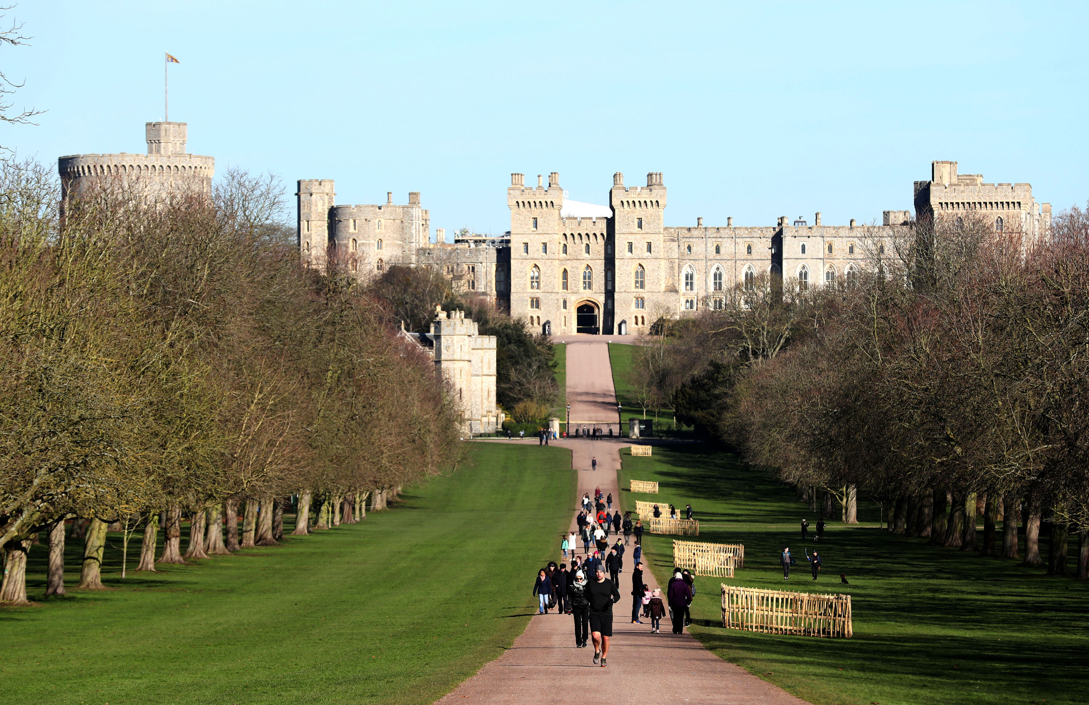 Blue skies over Windsor Castle in Berkshire, as people walk along the Long Walk. Steve Parsons - PA Images—Getty Images