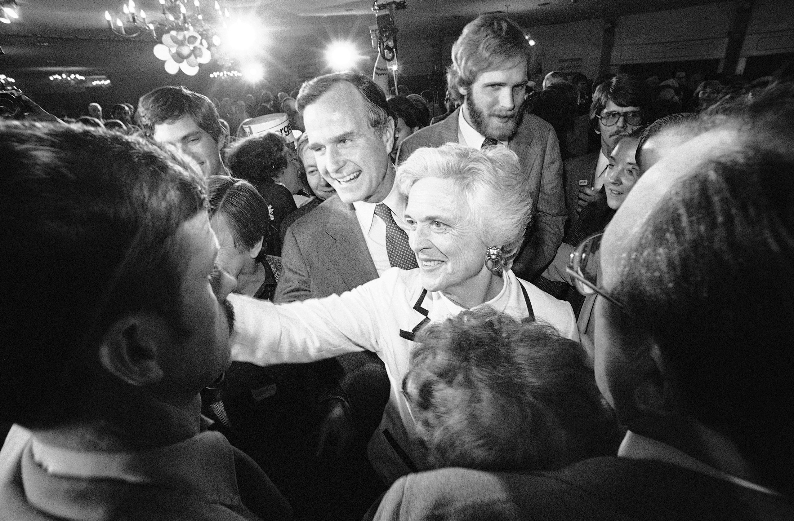 Former CIA director George Bush and his wife, Barbara, smile and shake hands with supporters as Bush left a Concord hotel ballroom after he spoke with supporters in Concord on Tuesday, Feb. 26, 1980.