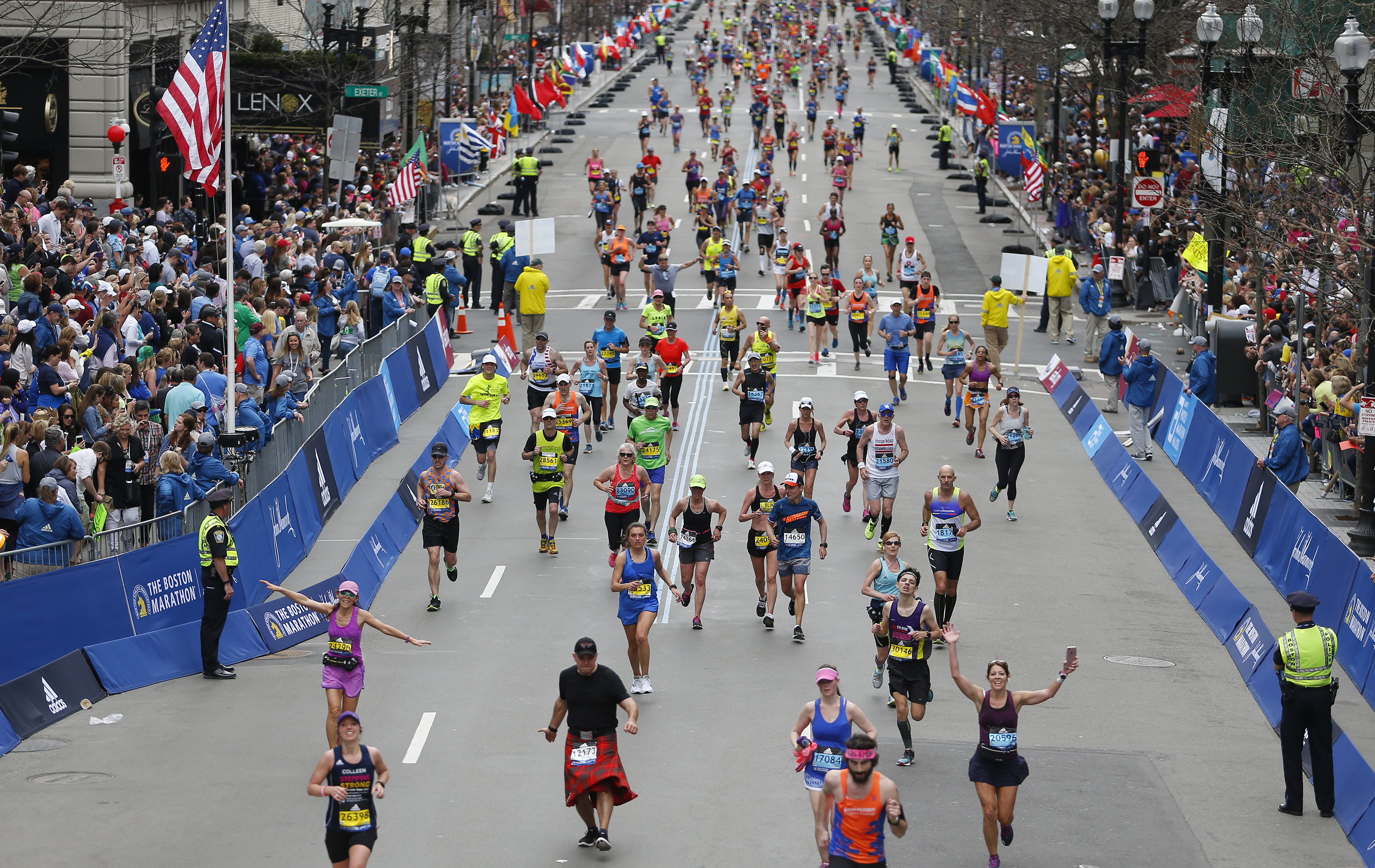 Runners make their way toward the finish line of the 121st Boston Marathon in Boston on Apr. 17, 2017.