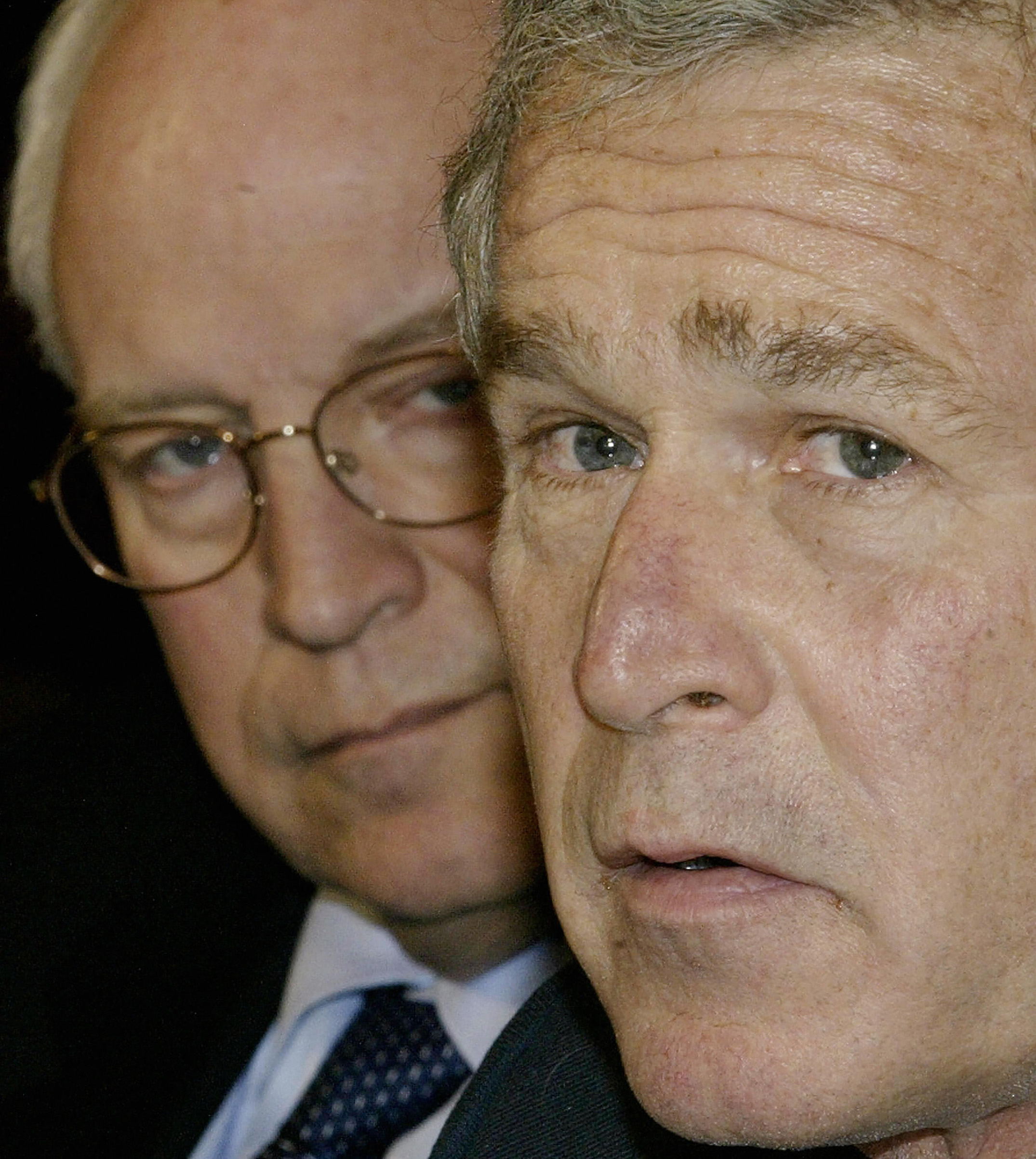 President George W. Bush speaks to reporters during a meeting with economists in the Roosevelt Room of The White House as Vice President Dick Cheney looks on in Washington, on Jan. 30, 2004.