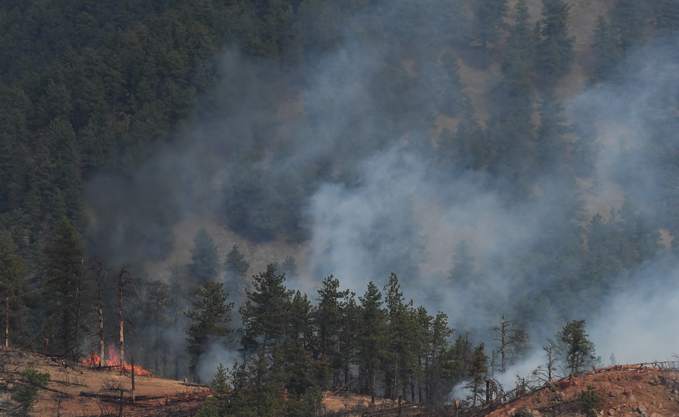 Fire crews work a wildfire in Sunshine Canyon on March 19, 2017 in Boulder, Colorado.