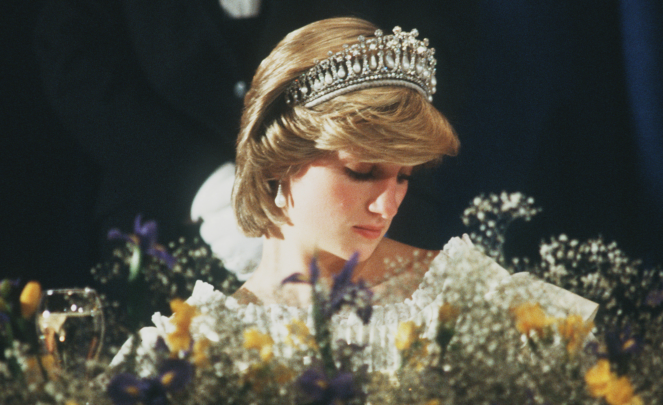 Diana, Princess of Wales wears the Cambridge Lover's Knot tiara (Queen Mary's Tiara) and diamond earrings during a banquet on April 29, 1983 in Aukland, New Zealand.
