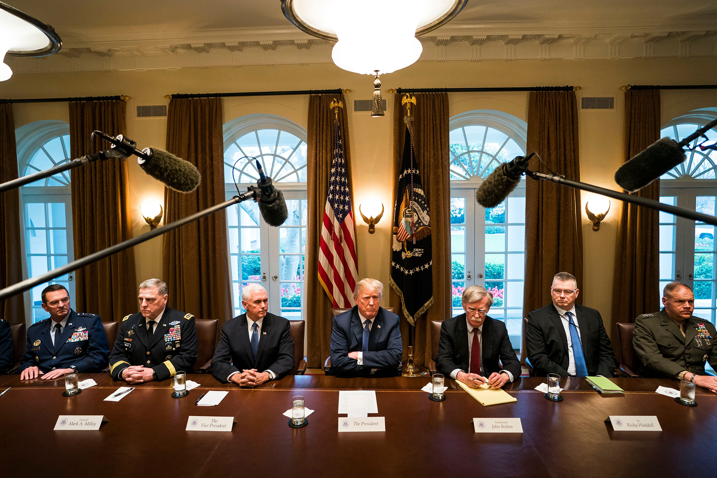 US President Donald J. Trump (C) speaks with the media before a meeting with his military leadership in the Cabinet Room of the White House in Washington D.C., on April 9, 2018.