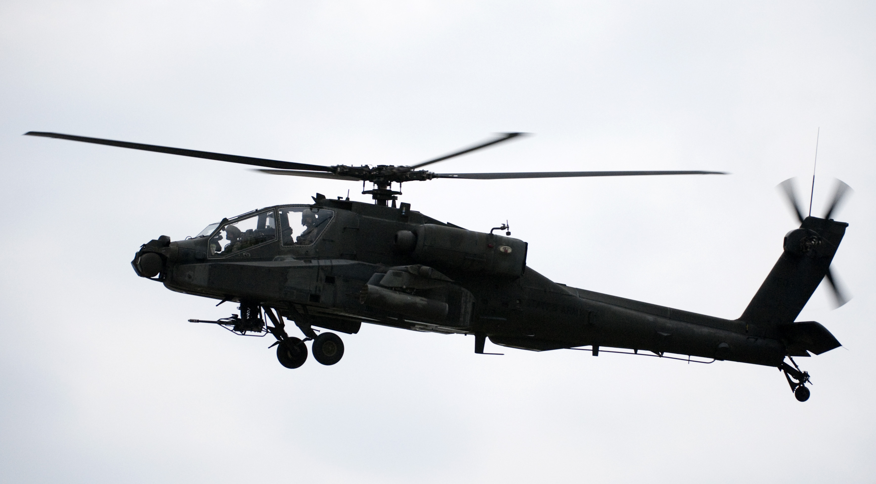 An Apache helicopter hovers over the race track during pre race ceremony before the start of the IRL IndyCar Series Meijer Indy 300 on August 1, 2009 at the Kentucky Speedway in Sparta, Kentucky.