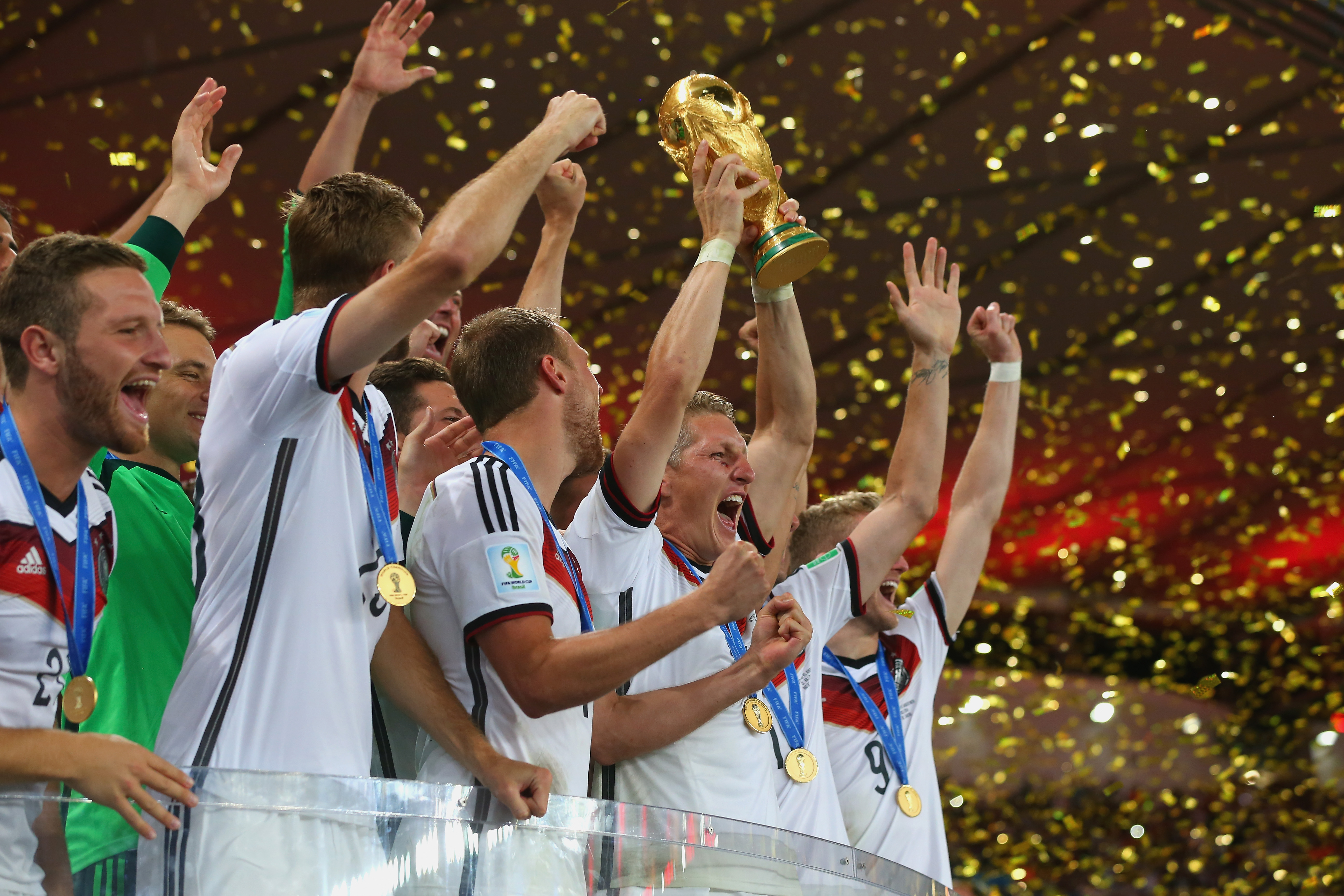 Germany's Bastian Schweinsteiger and teammates lift the World Cup trophy to celebrate the country's 2014 FIFA World Cup win in Rio de Janeiro, Brazil. Alexander Hassenstein - FIFA/FIFA via Getty Images