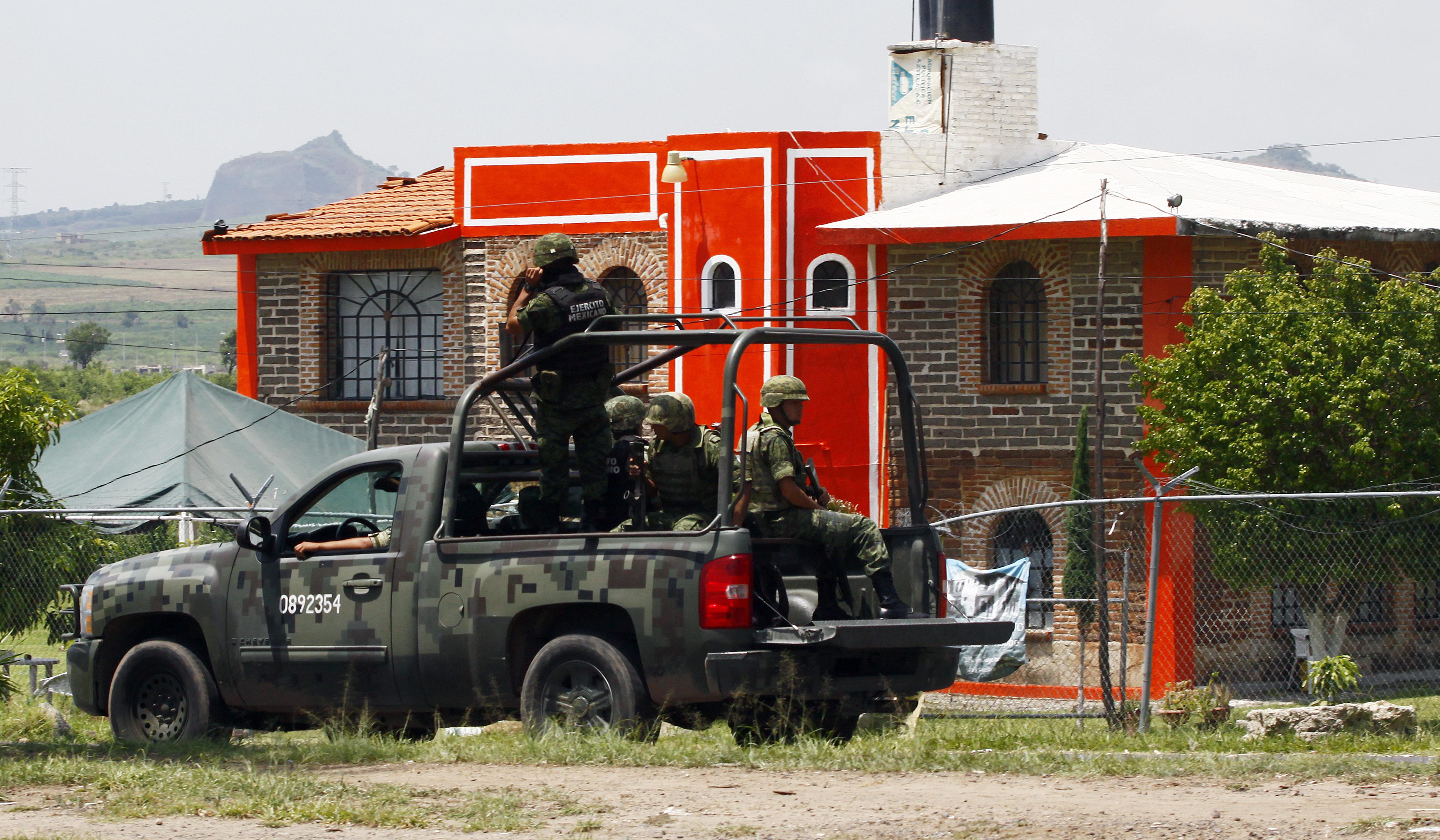 Soldiers patrol the Puente Grande State prison where Mexican cartel boss Rafael Caro Quintero was jailed in Zapotlanejo, Jalisco State, Mexico, on Aug. 9, 2013.