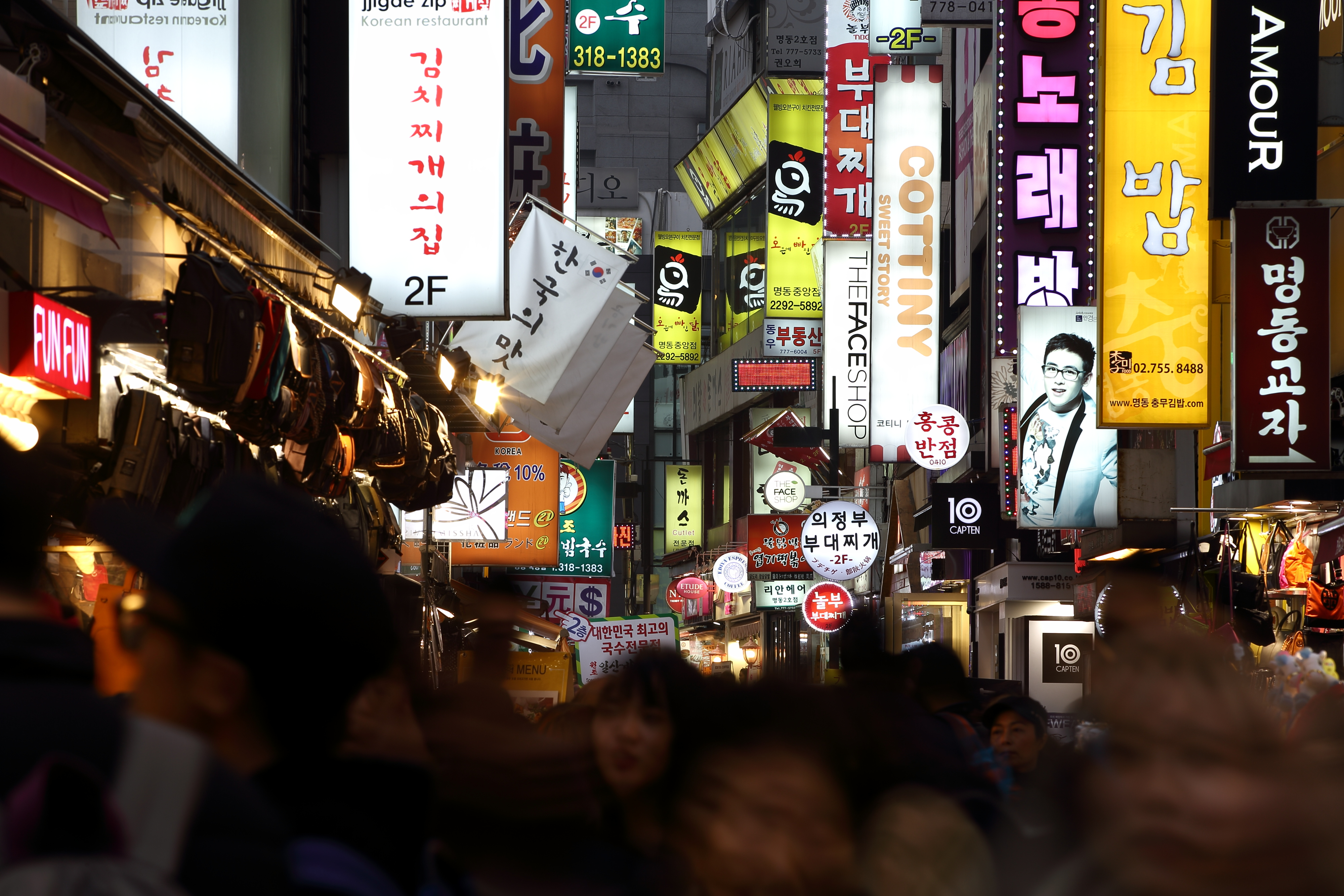 Illuminated signboards light up a street in the evening in the Myeongdong district of Seoul, South Korea, on Feb. 27, 2014.