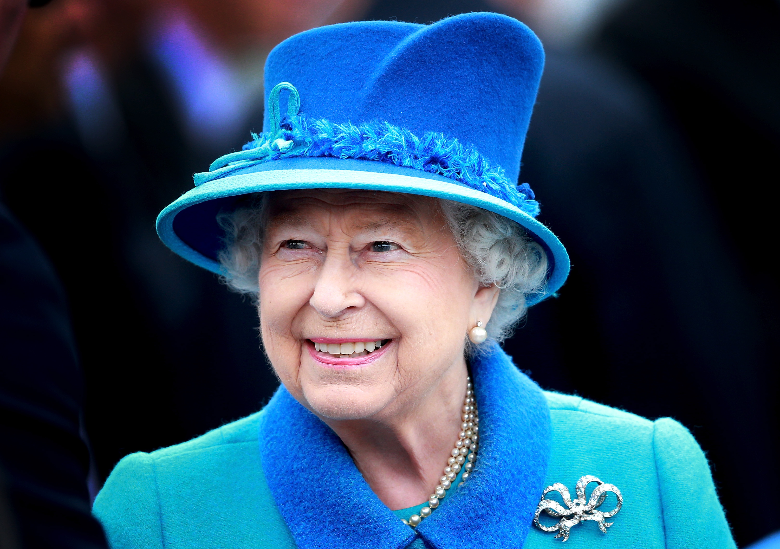 Queen Elizabeth II smiles as she arrives at Tweedbank Station on September 9, 2015 in Tweedbank, Scotland.