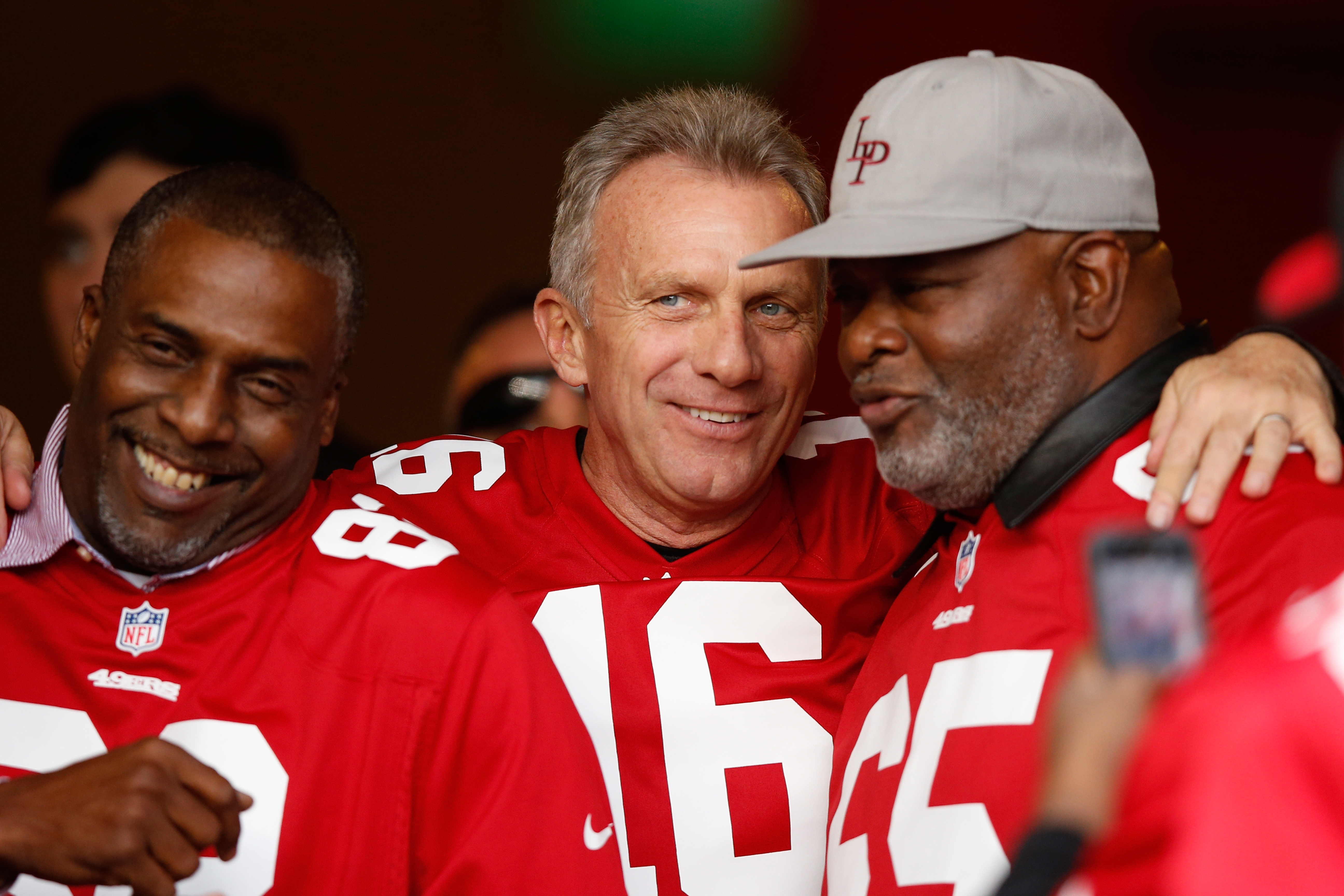 Former San Francisco 49ers players John Taylor, Joe Montana and Lawrence Pillers are seen during a ceremony honoring the 1981-82 team at halftime of the NFL game between the San Francisco 49ers and the Cincinnati Bengals at Levi's Stadium on December 20, 2015 in Santa Clara, California.
