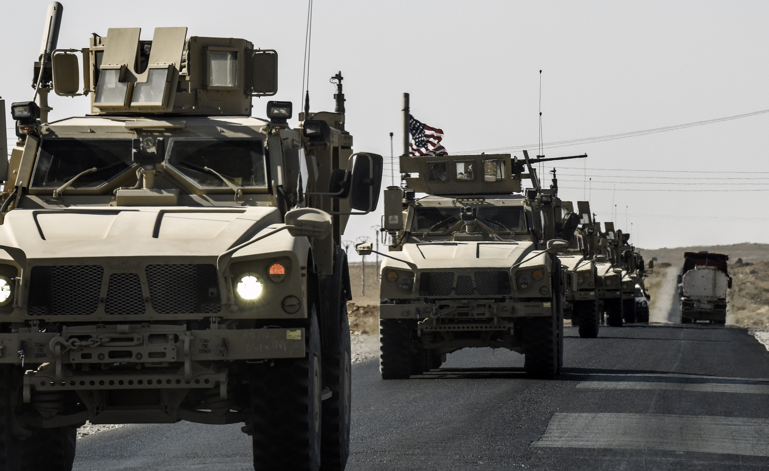 A U.S. military convoy drives on a highway from Kobane to Ain Issa on Sept. 29, 2017.
