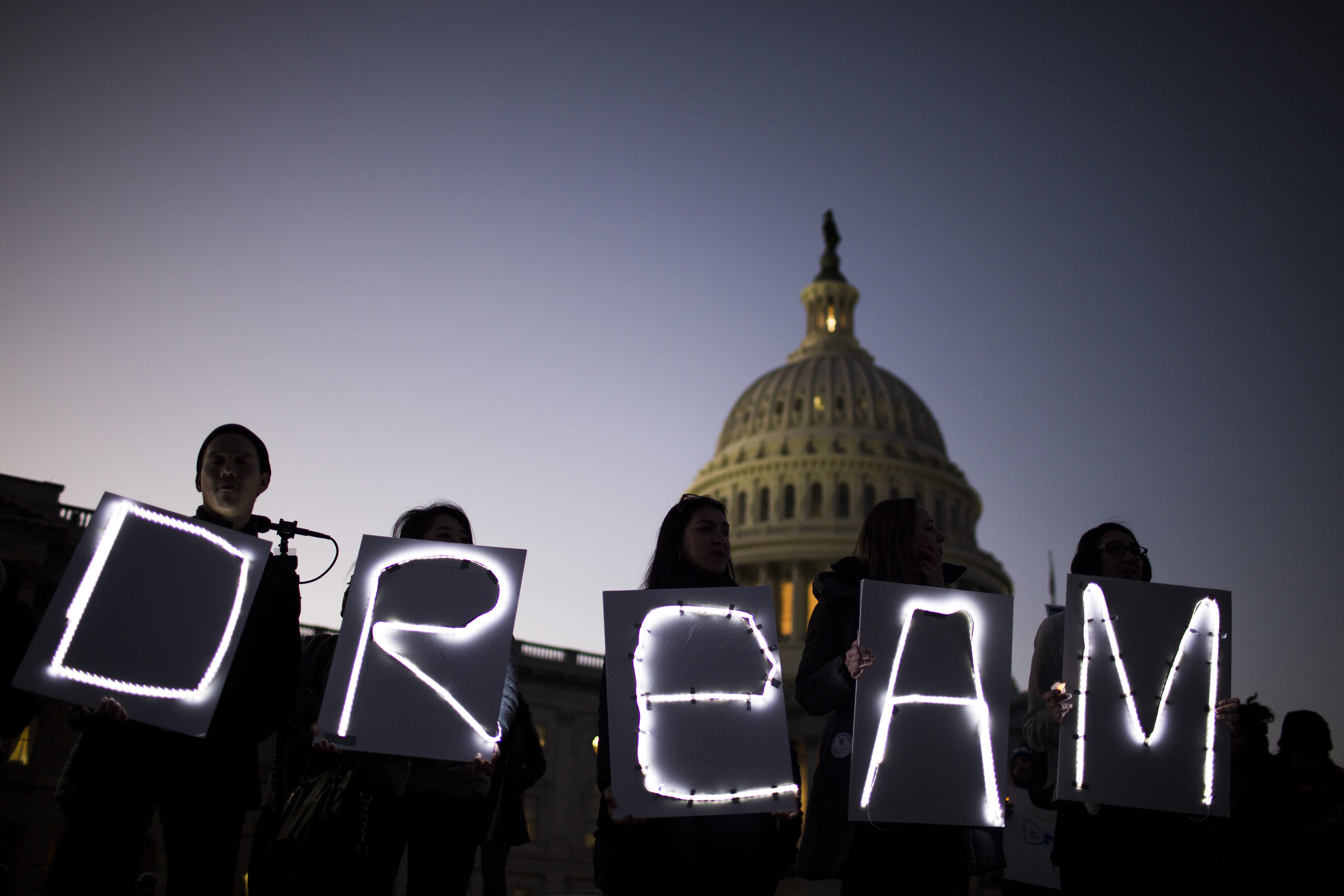 Demonstrators hold illuminated signs during a rally supporting the Deferred Action for Childhood Arrivals program (DACA), or the Dream Act, outside the U.S. Capitol building in Washington, D.C., U.S., on Jan. 18, 2018.