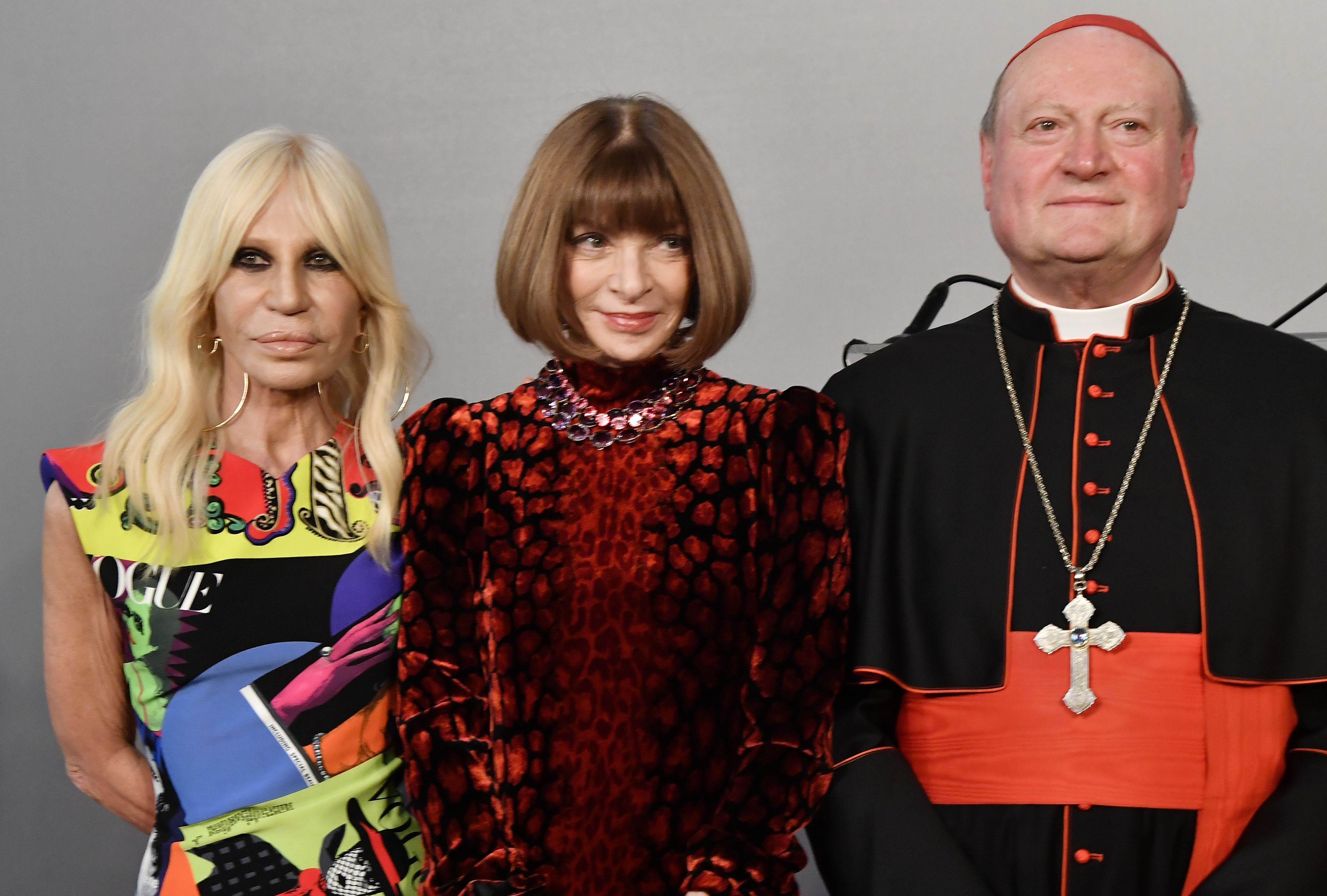 Italian designer Donatella Versace with editor-in-chief of Vogue Anna Wintour and cardinal Gianfranco Ravasi, President of the Vatican Pontifical Council for Culture, at Rome's Palazzo Colonna on Feb. 26, 2018.