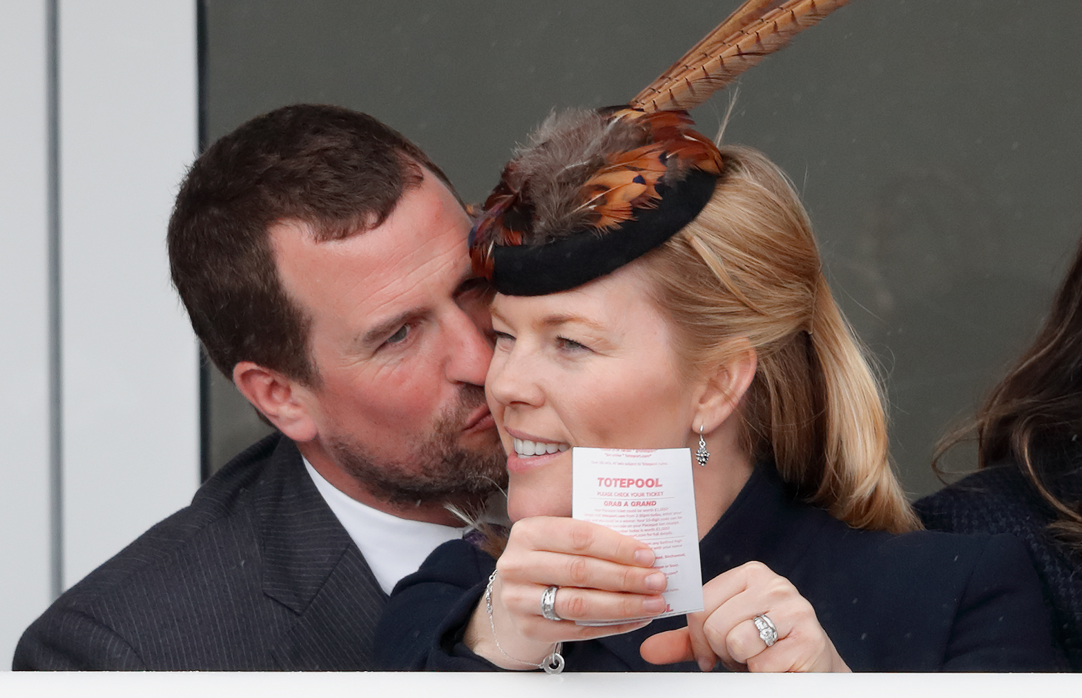 Peter Phillips kisses wife Autumn Phillips as they attend day 4 'Gold Cup Day' of the Cheltenham Festival at Cheltenham Racecourse on March 16, 2018 in Cheltenham, England.