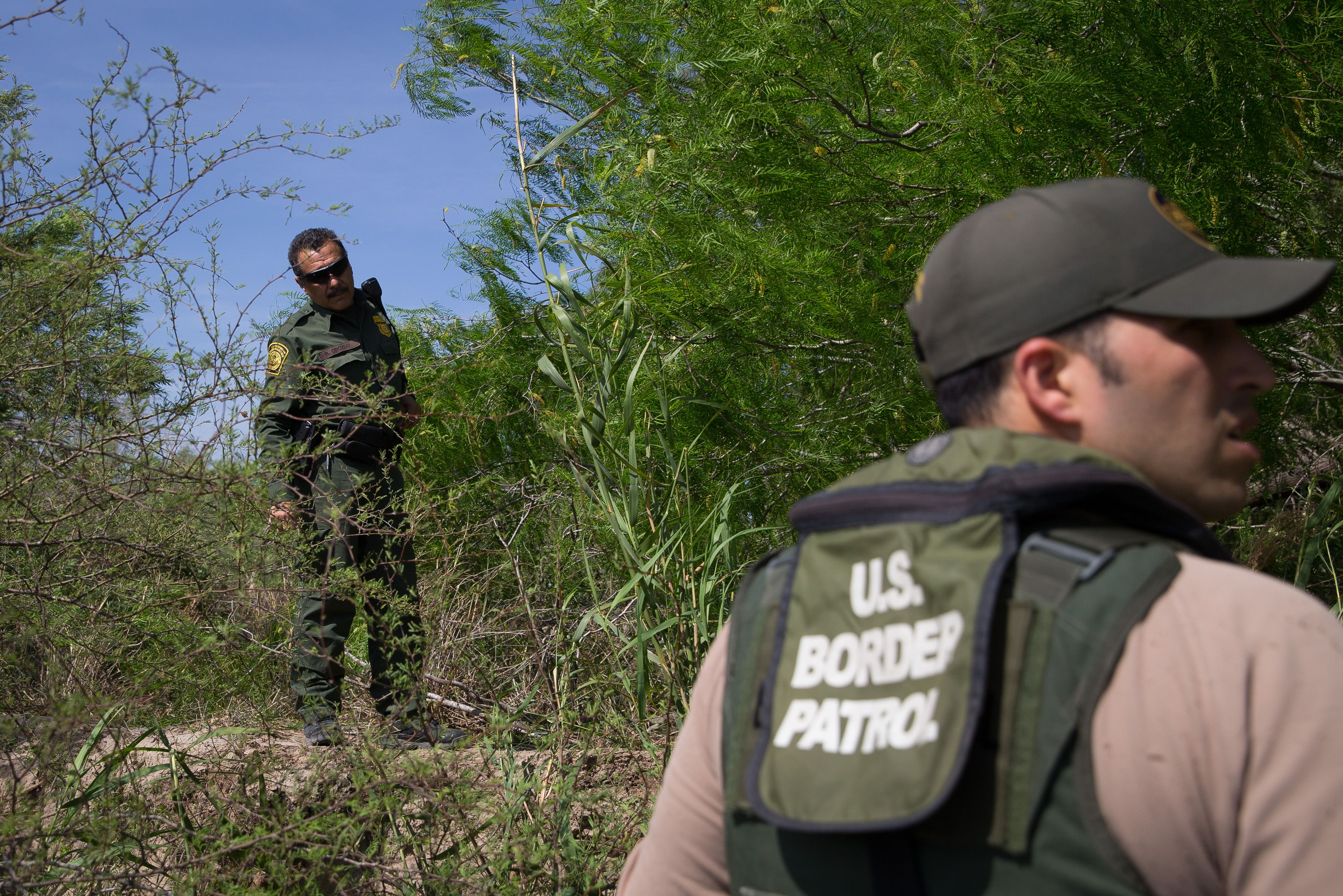 Border Patrol agents search the Rio Grande River for illegal immigrants crossing the border from Mexico into the United States near McAllen, Texas on Monday, March 26, 2018.