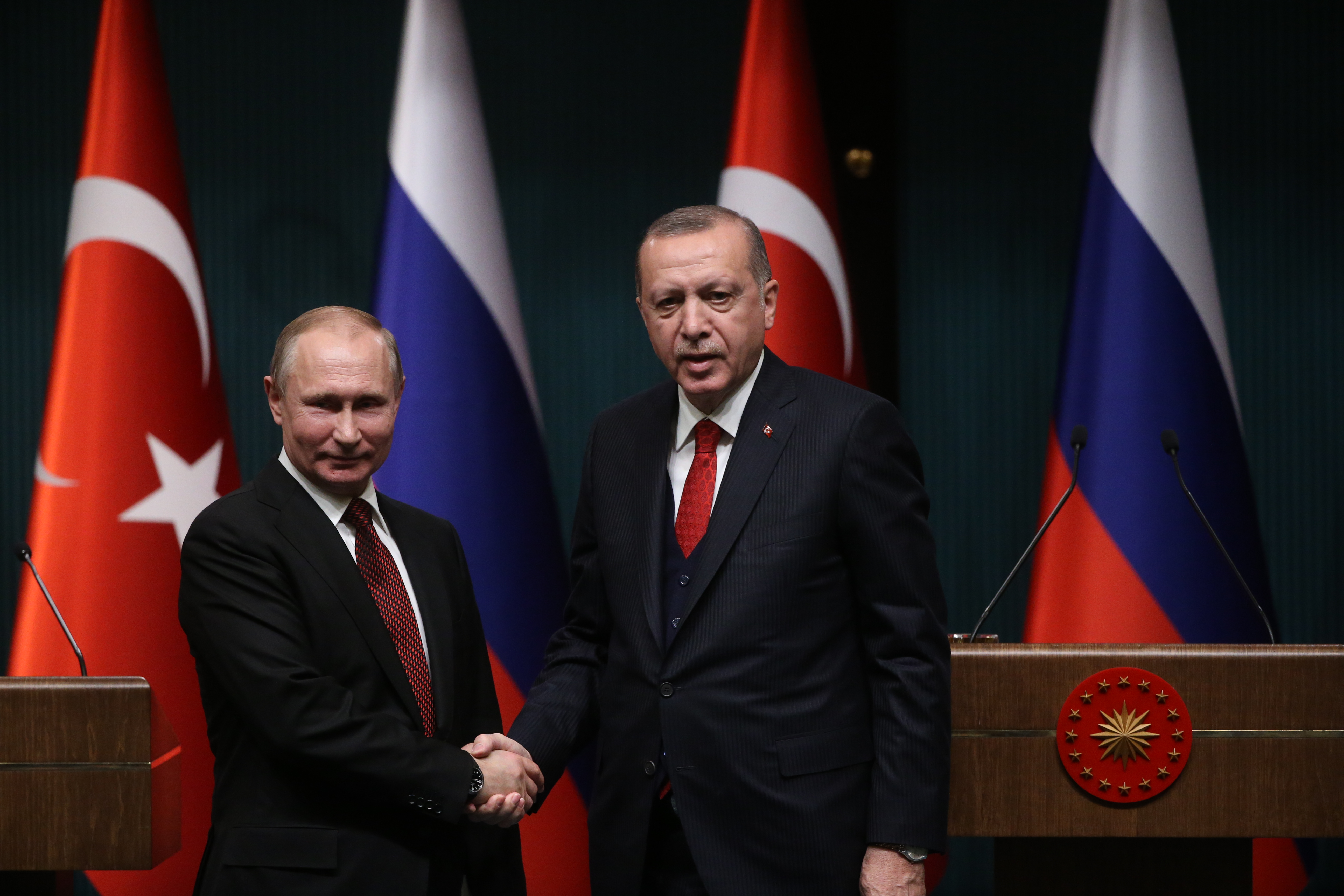 Russian President Vladimir Putin shakes hands with Turkish President Recep Tayyip Erdogan during their joint press conference at the presidential palace on April 3, 2018 in Ankara, Turkey.