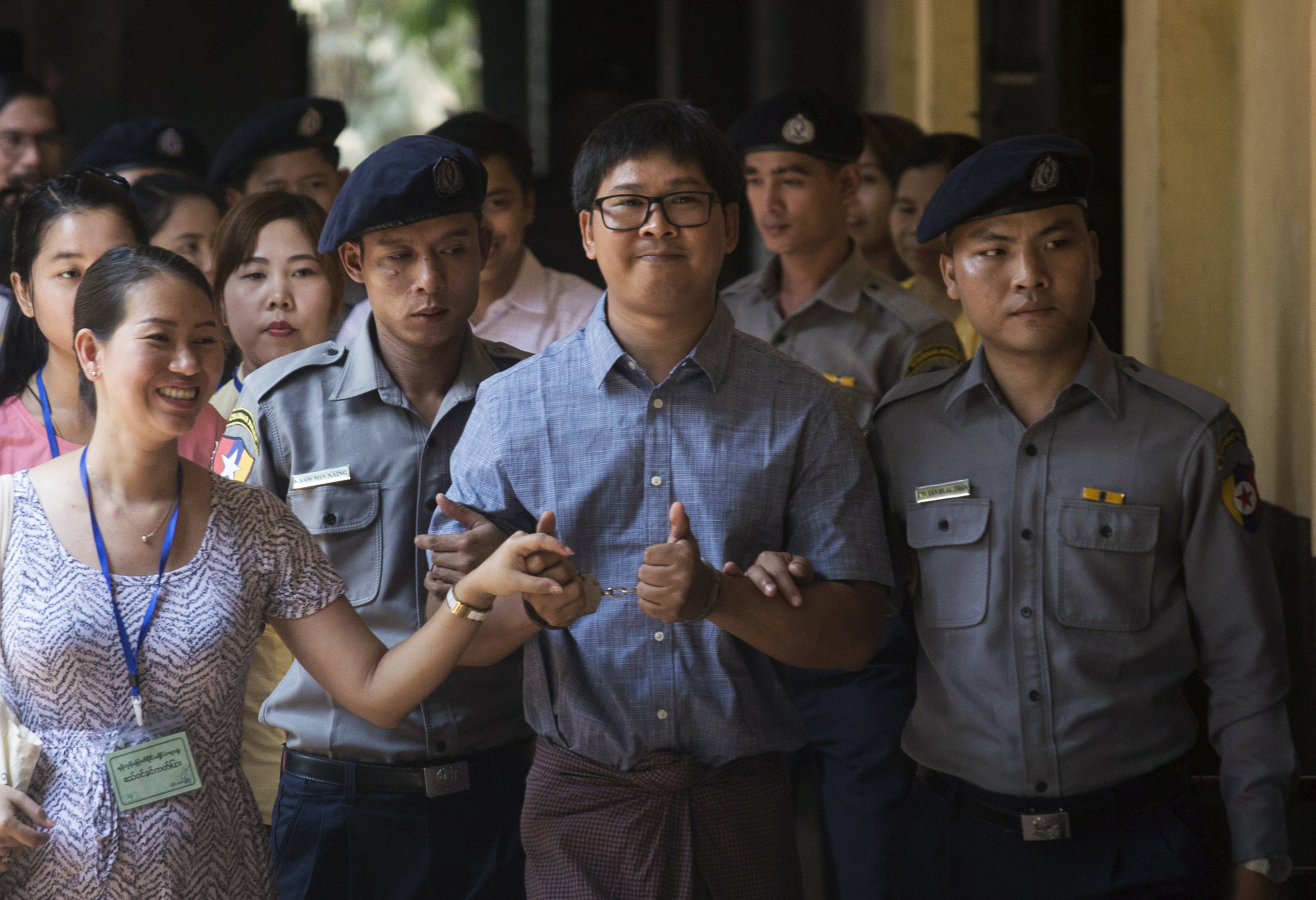 Detained Myanmar journalist Wa Lone arrives at court for his trial in Yangon on April 4, 2018.