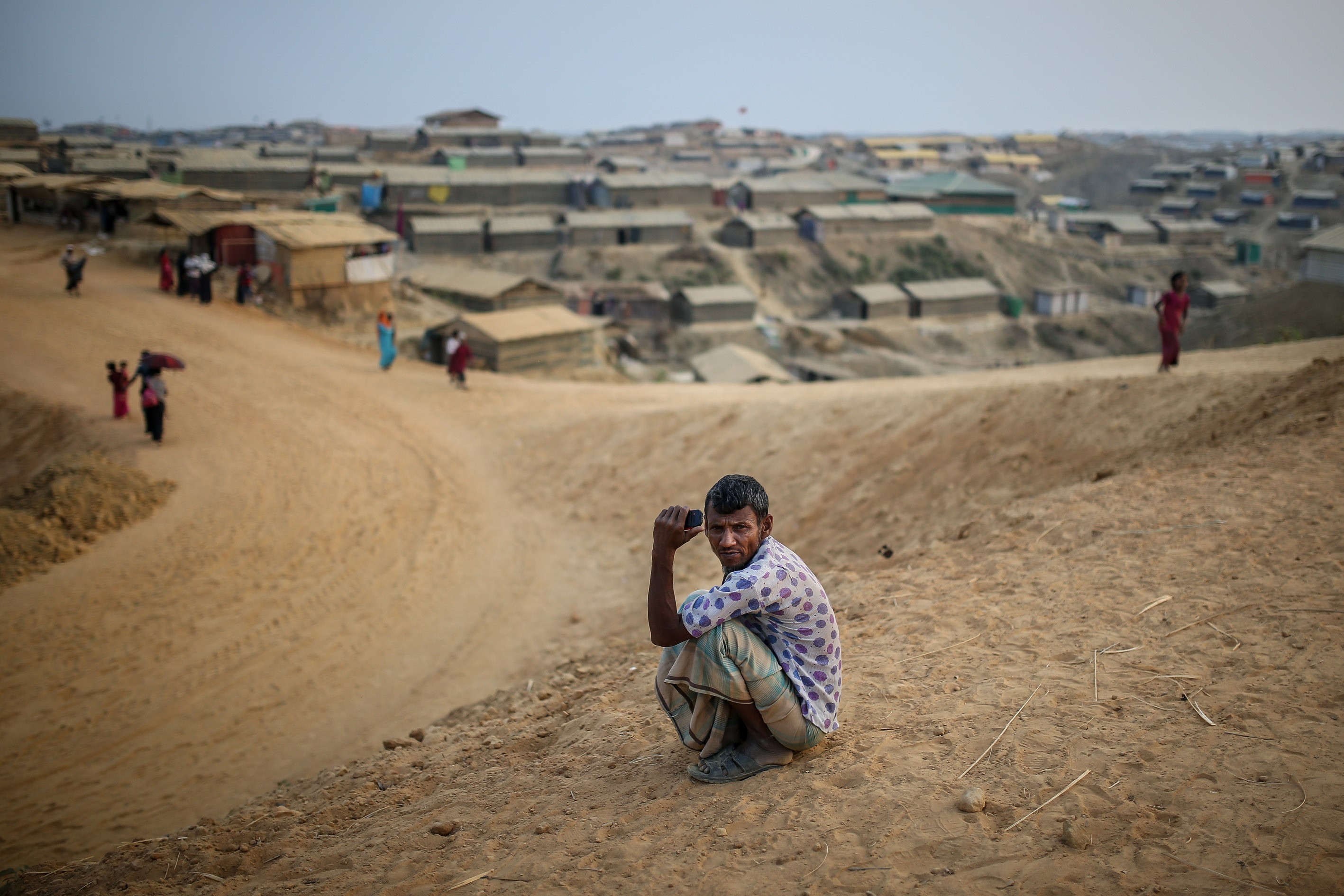 A Rohingya man sits on the ground in the at Kutupalong refugee camp near Cox's Bazar, Bangladesh on April 7, 2018.