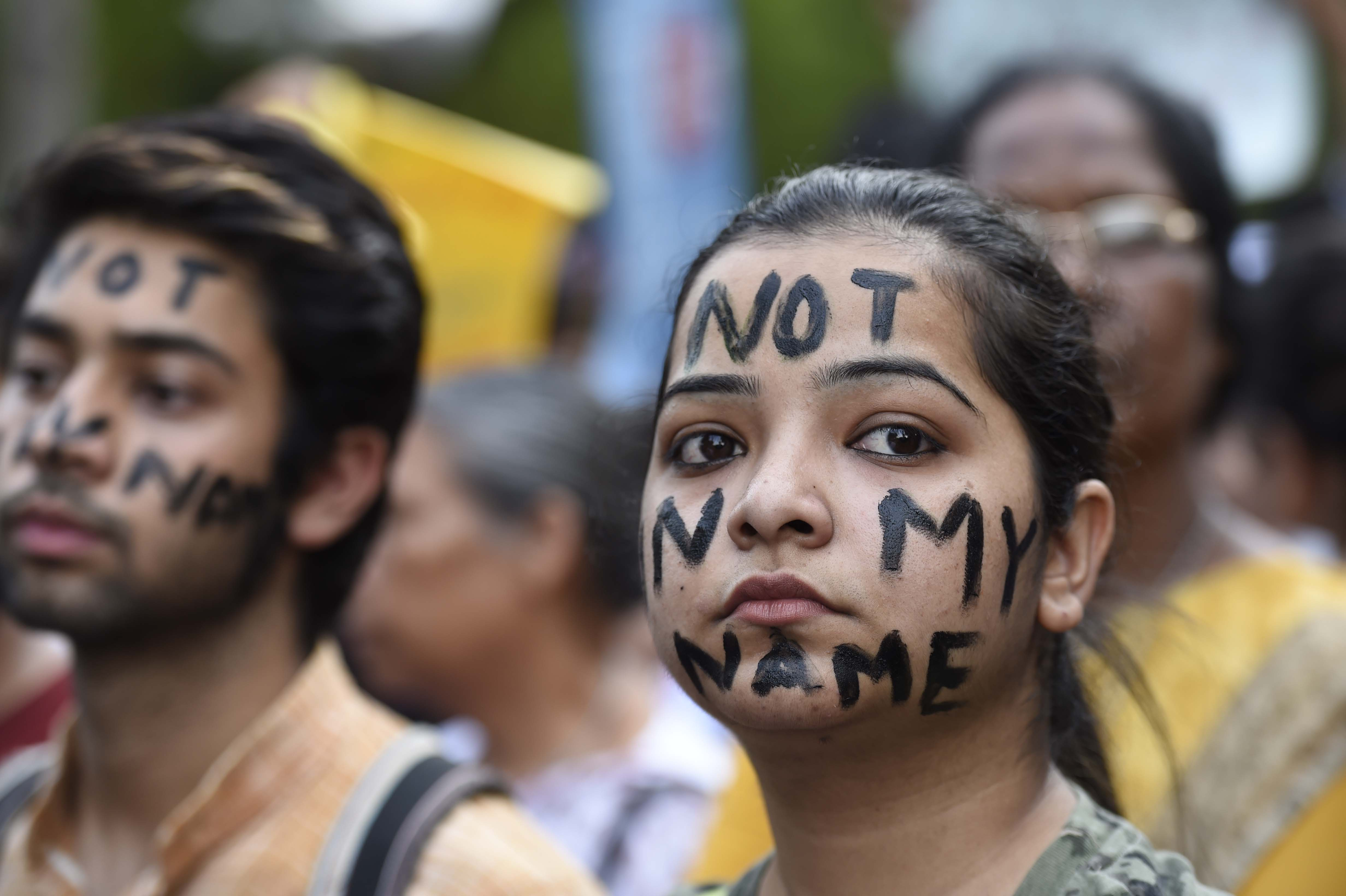 People take part in a 'Not In My Name' protest against the Kathua and Unnao rape cases, New Delhi, April 15, 2018.